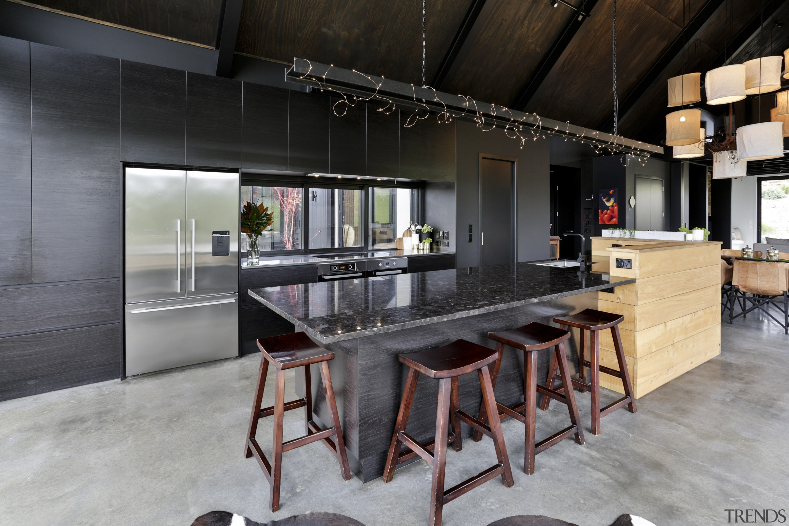 In this semi-industrial kitchen by Carlielle Kitchens a countertop, interior design, kitchen, loft, table, gray, black
