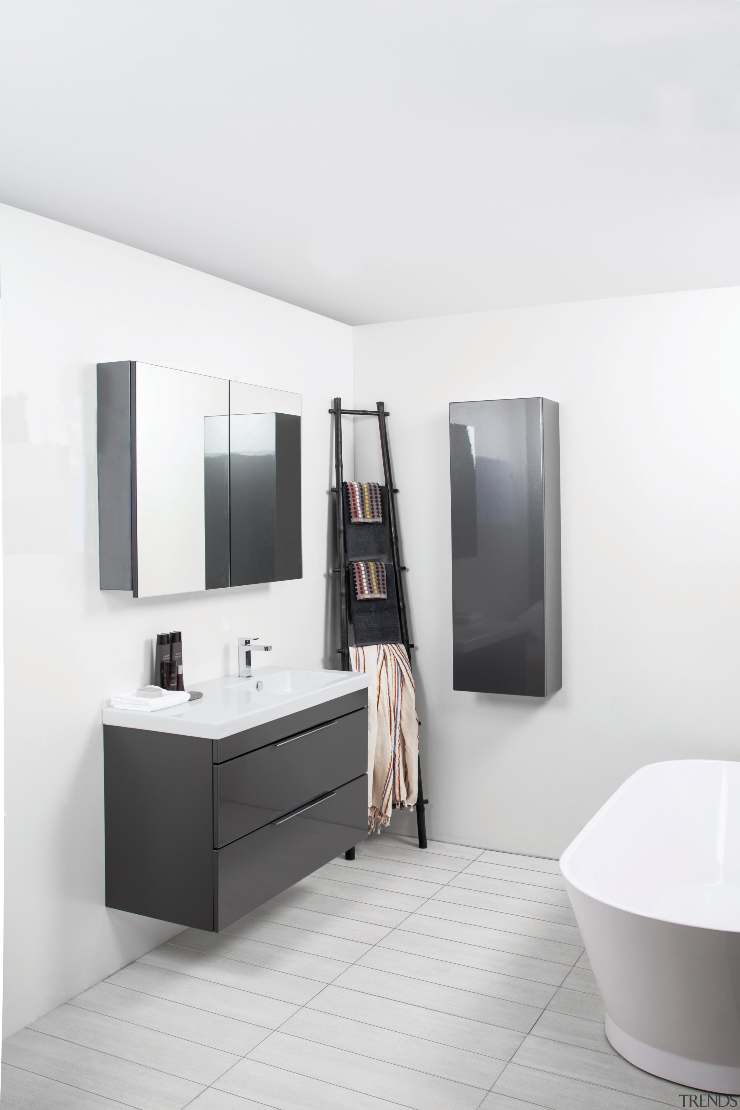 This bathroom highlights Adesso bathroomware, which combines European bathroom, bathroom accessory, bathroom cabinet, floor, interior design, plumbing fixture, product design, room, sink, tap, white