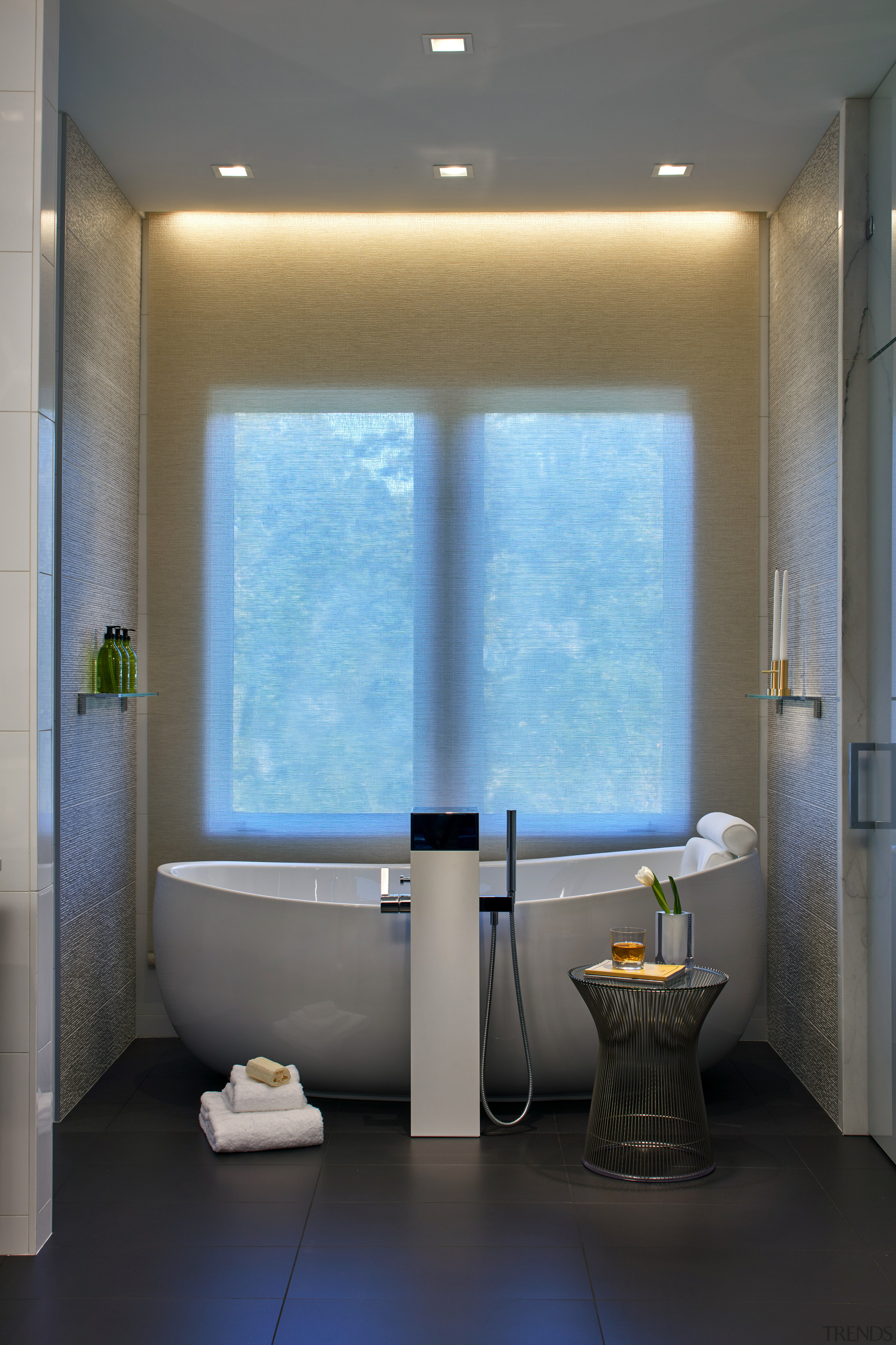 The luxury of pure symmetry is apparent in architecture, bathroom, ceiling, daylighting, interior design, plumbing fixture, room, toilet, window, gray