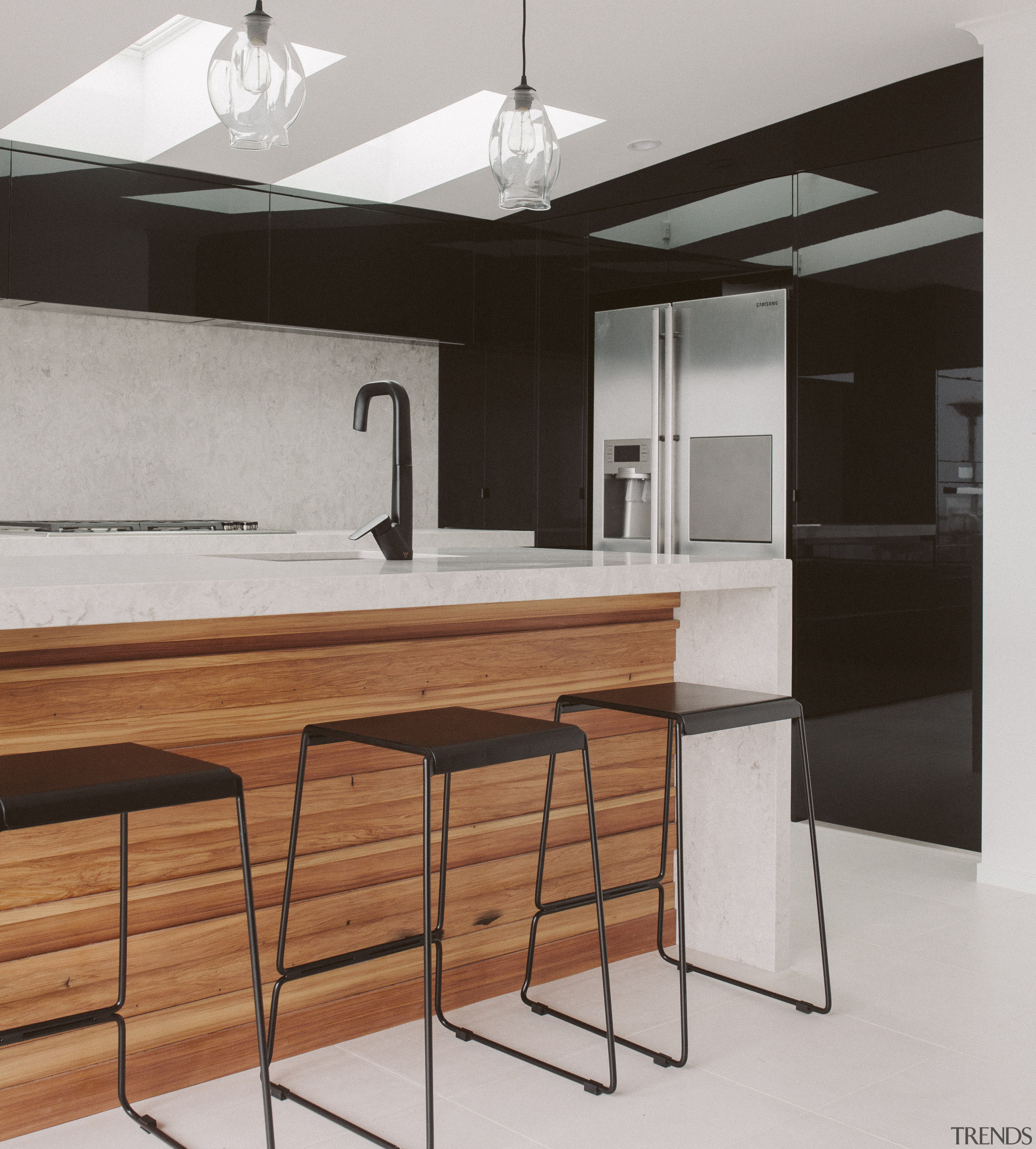 Black gloss cabinetry reflecst the sea, and stone cabinetry, countertop, floor, furniture, interior design, kitchen, table, gray, black