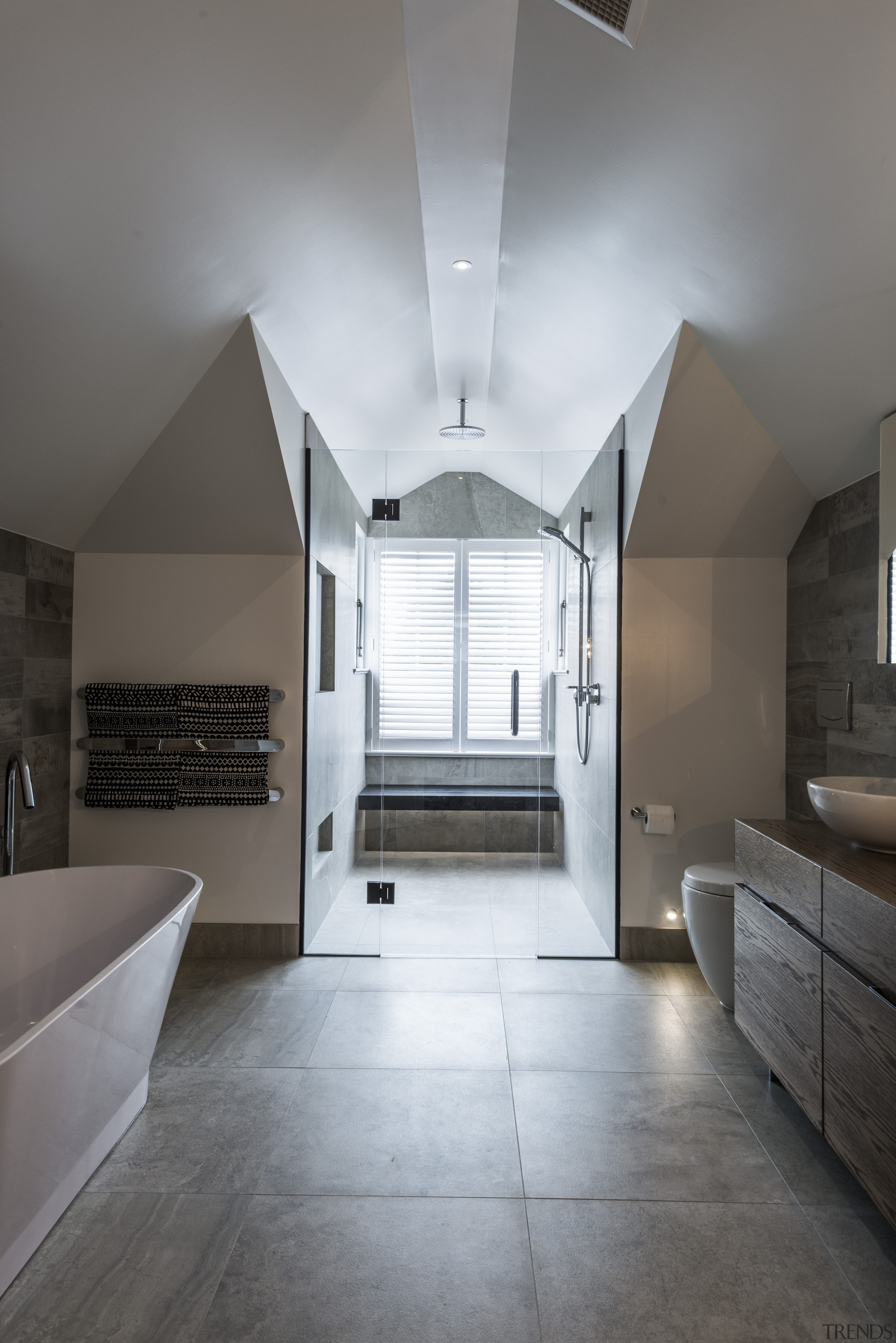 A rain showerhead is tucked up high into architecture, ceiling, daylighting, estate, floor, flooring, home, house, interior design, room, gray