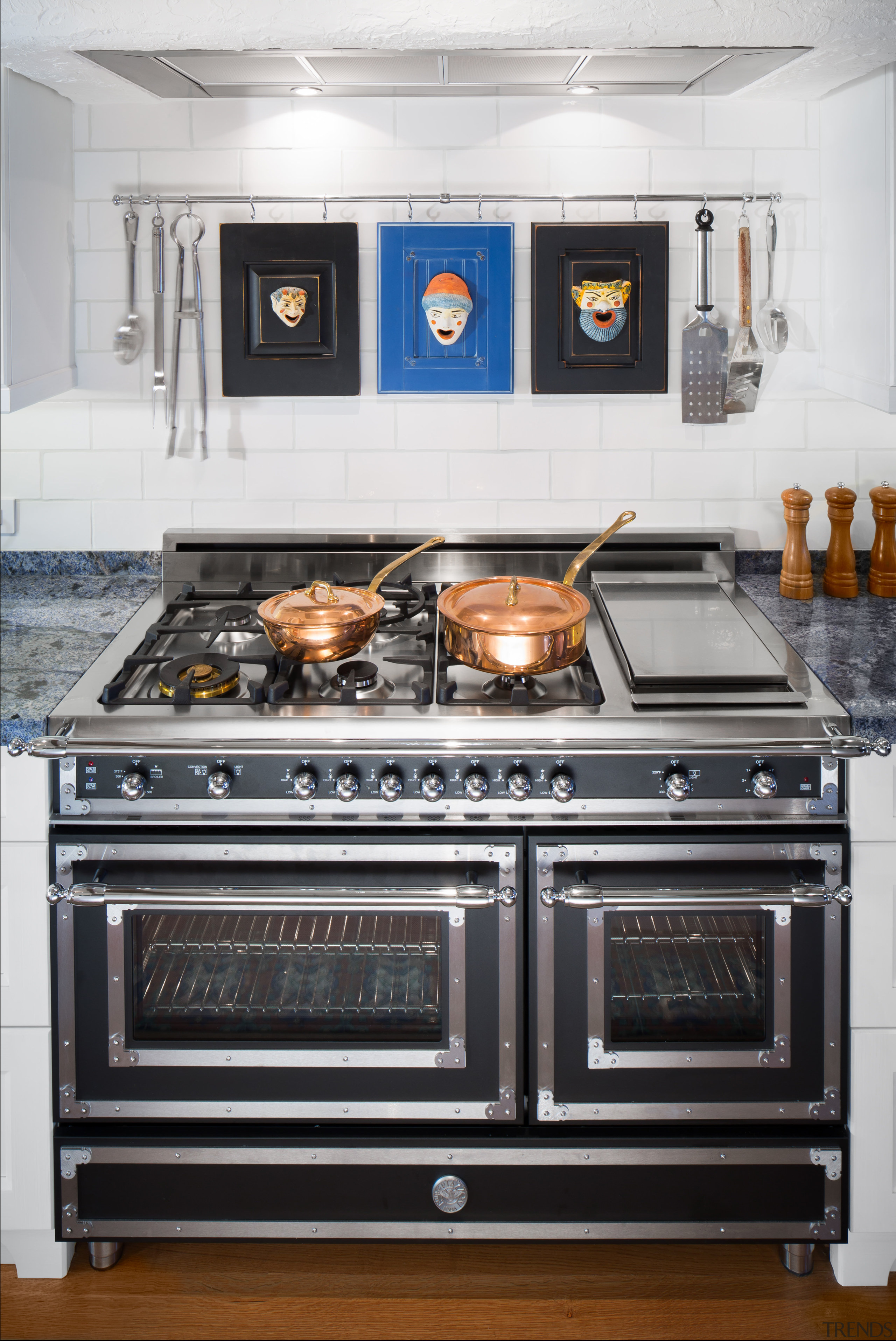This new kitchen by designer Elina Katsioula-Beall features countertop, gas stove, home appliance, kitchen, kitchen appliance, kitchen stove, major appliance, oven, stove, white, black
