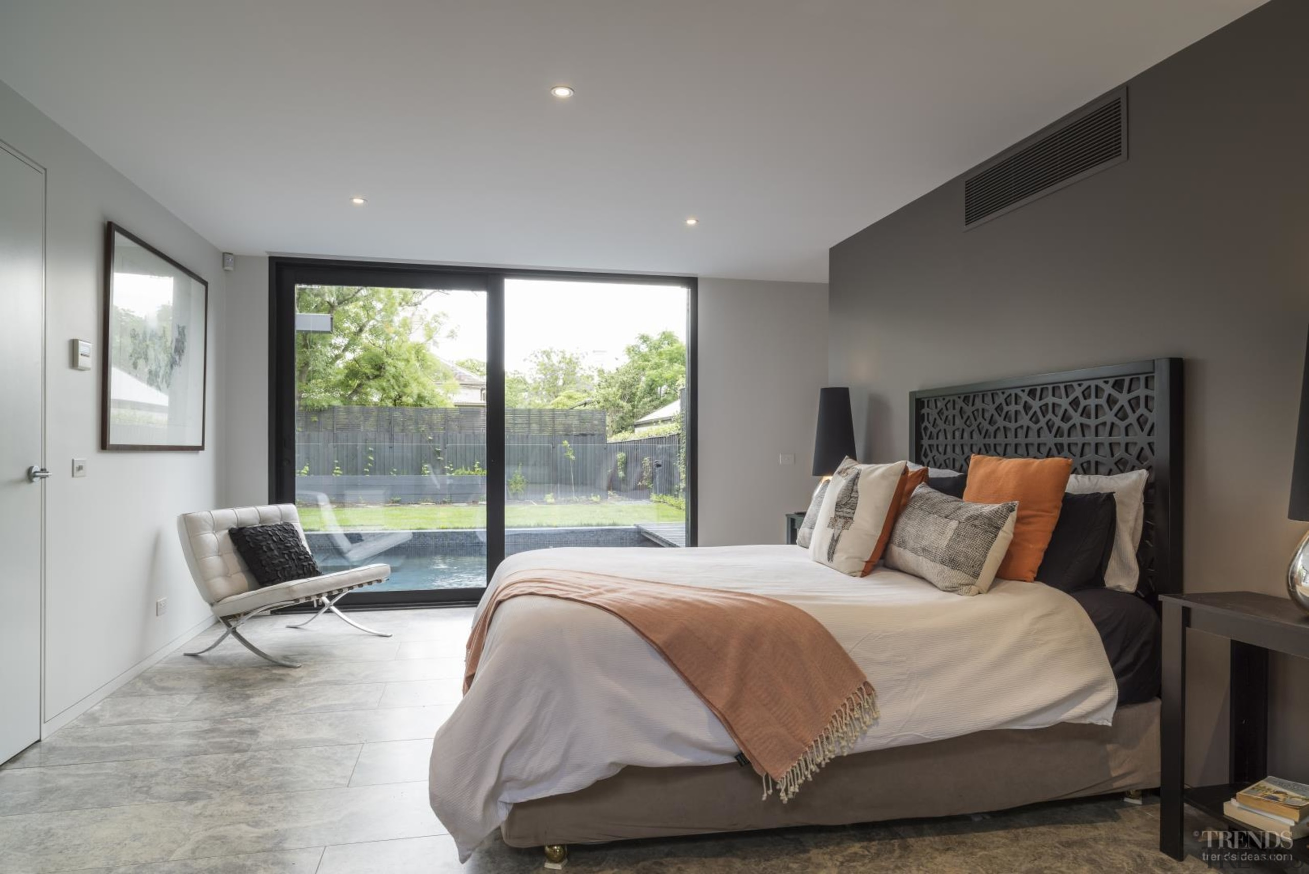 This master bedroom looks out to the home's bed frame, bedroom, ceiling, estate, floor, home, house, interior design, property, real estate, room, window, gray