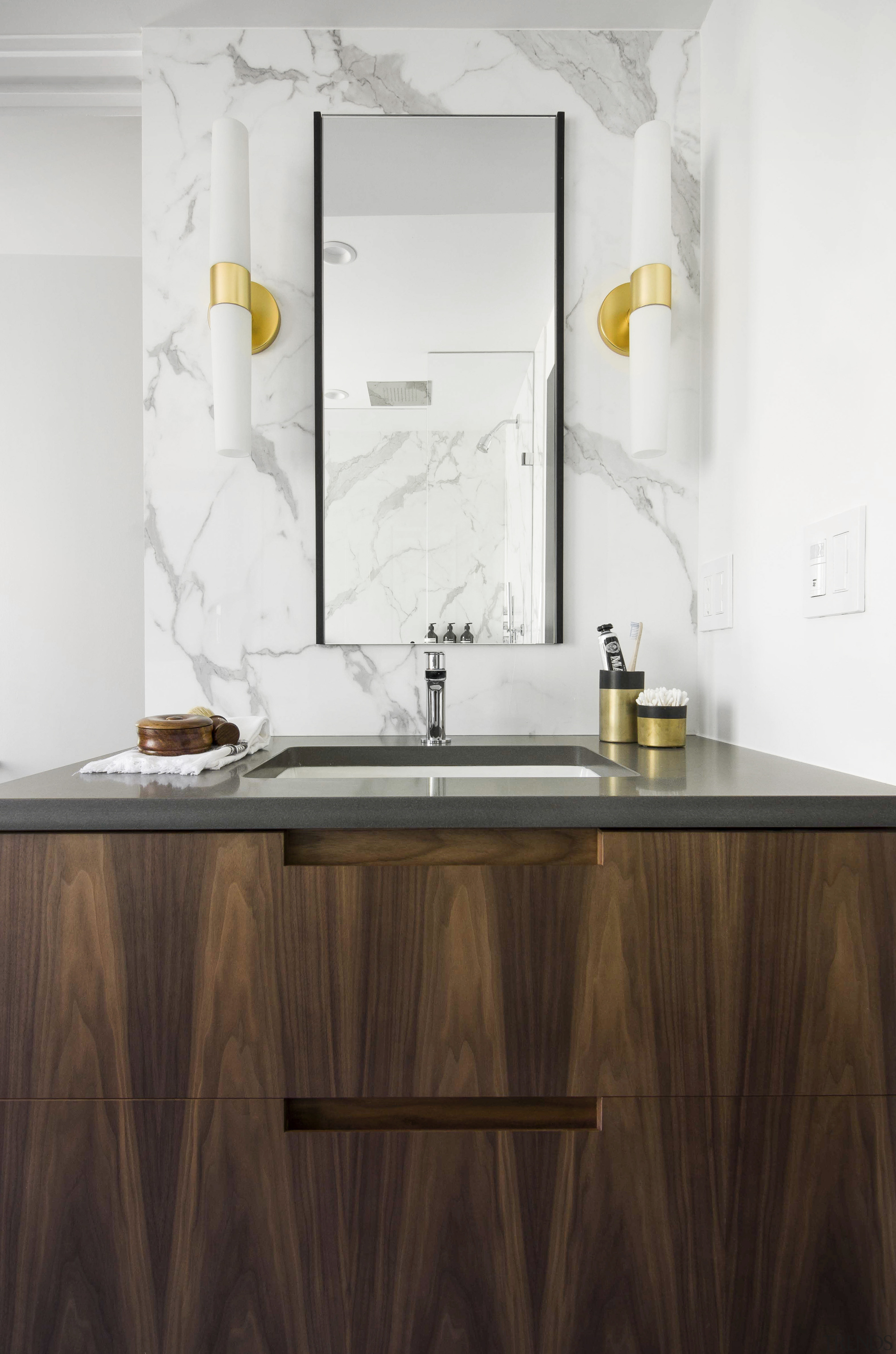 The custom walnut his and her vanities feature