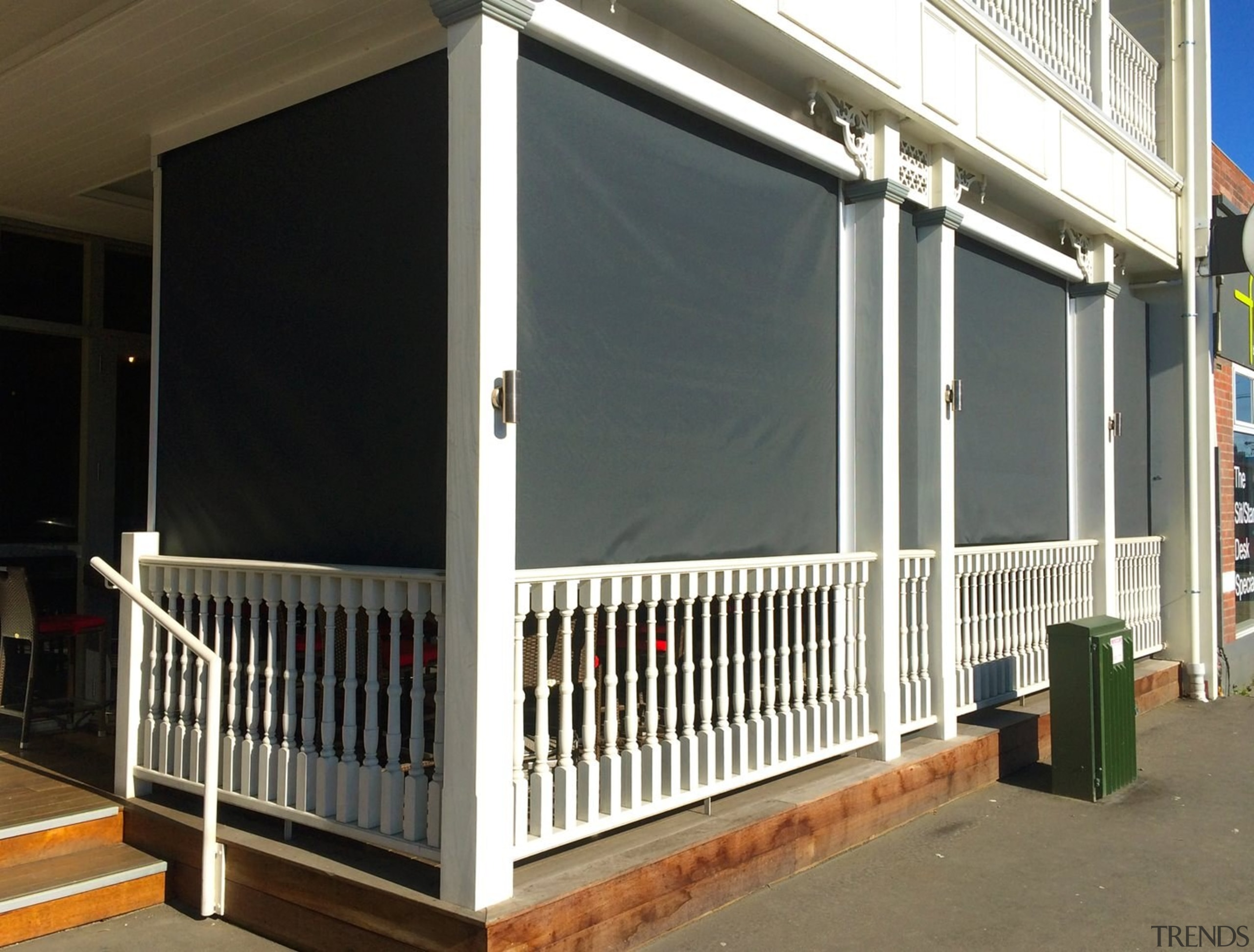 Calido Screens after being put down - Calido door, handrail, outdoor structure, porch, product, shade, structure, window, gray, black