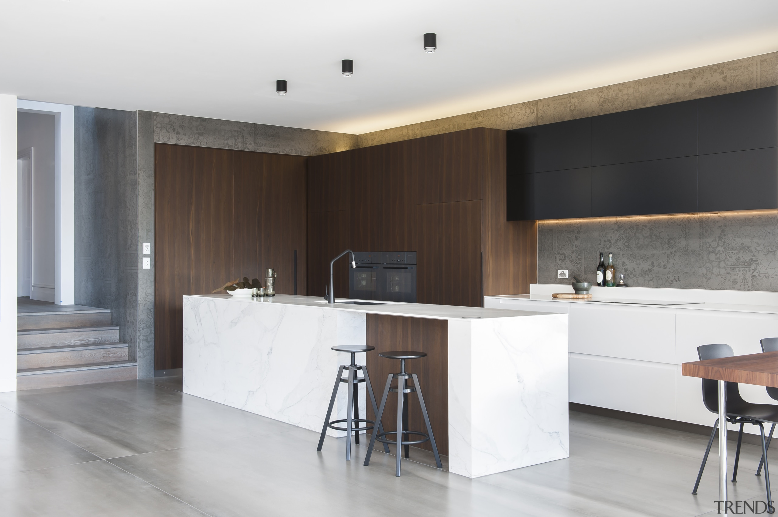 This kitchen is an elegant composition of crisp, architecture, cabinetry, countertop, cuisine classique, floor, flooring, interior design, kitchen, room, wood flooring, white