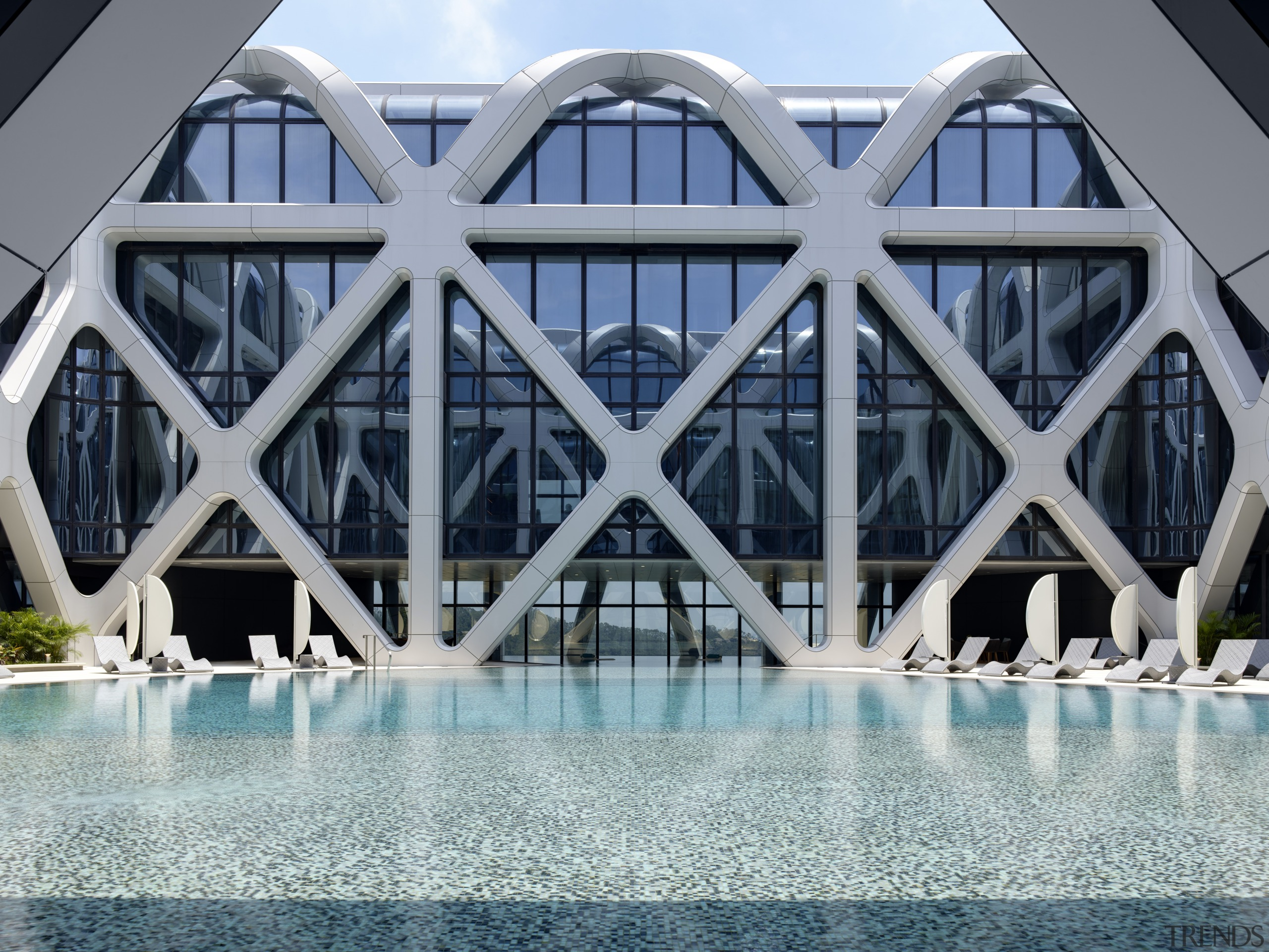 The rooftop pool offers an up-close-and-personal take on architecture, building, daylighting, daytime, reflection, structure, swimming pool, symmetry, water, gray
