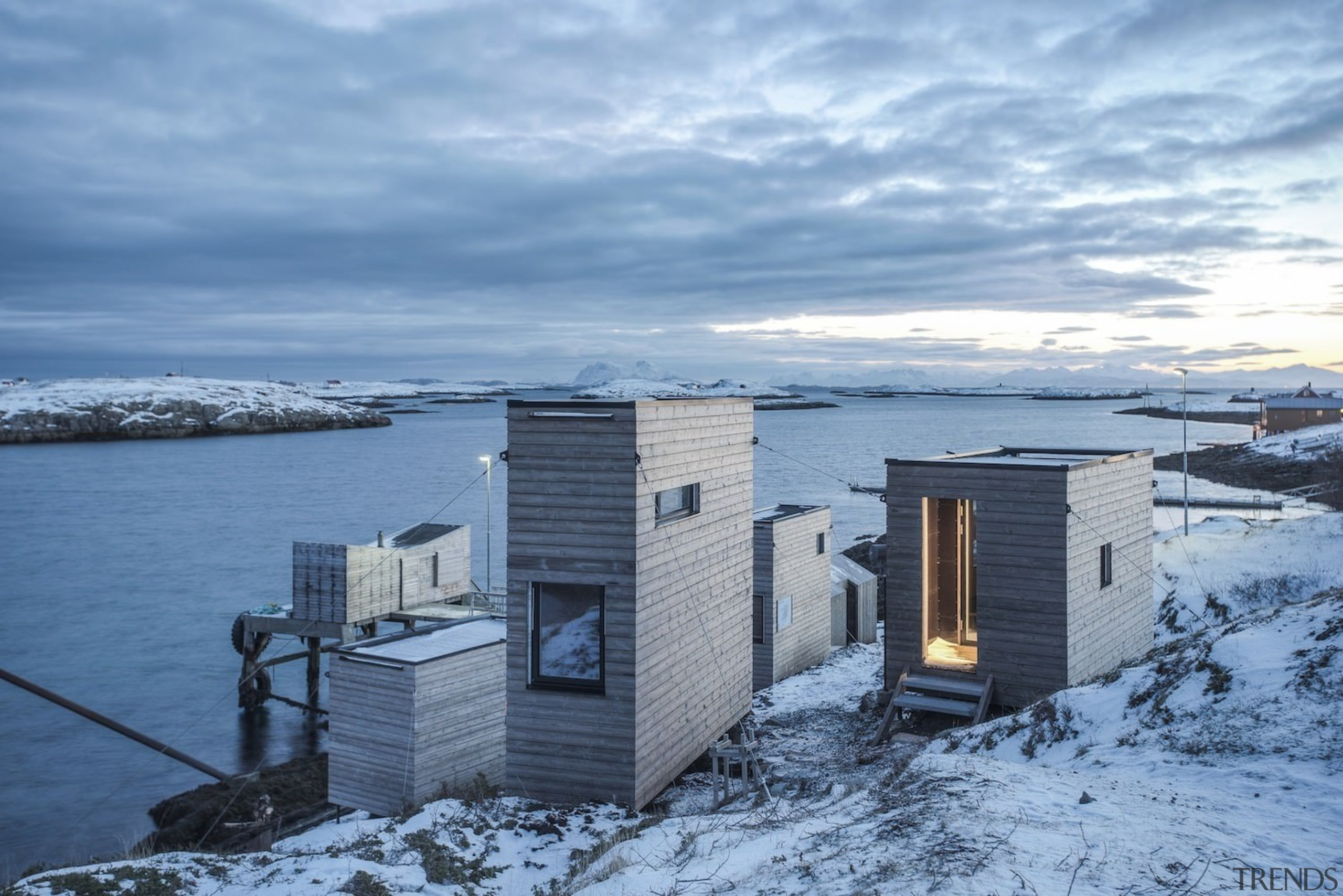 Architect: TYIN tegnestue ArchitectsPhotographer: Pasi Aalto / arctic, building, cloud, cottage, freezing, home, house, ice, real estate, roof, sea, sky, snow, water, winter, teal