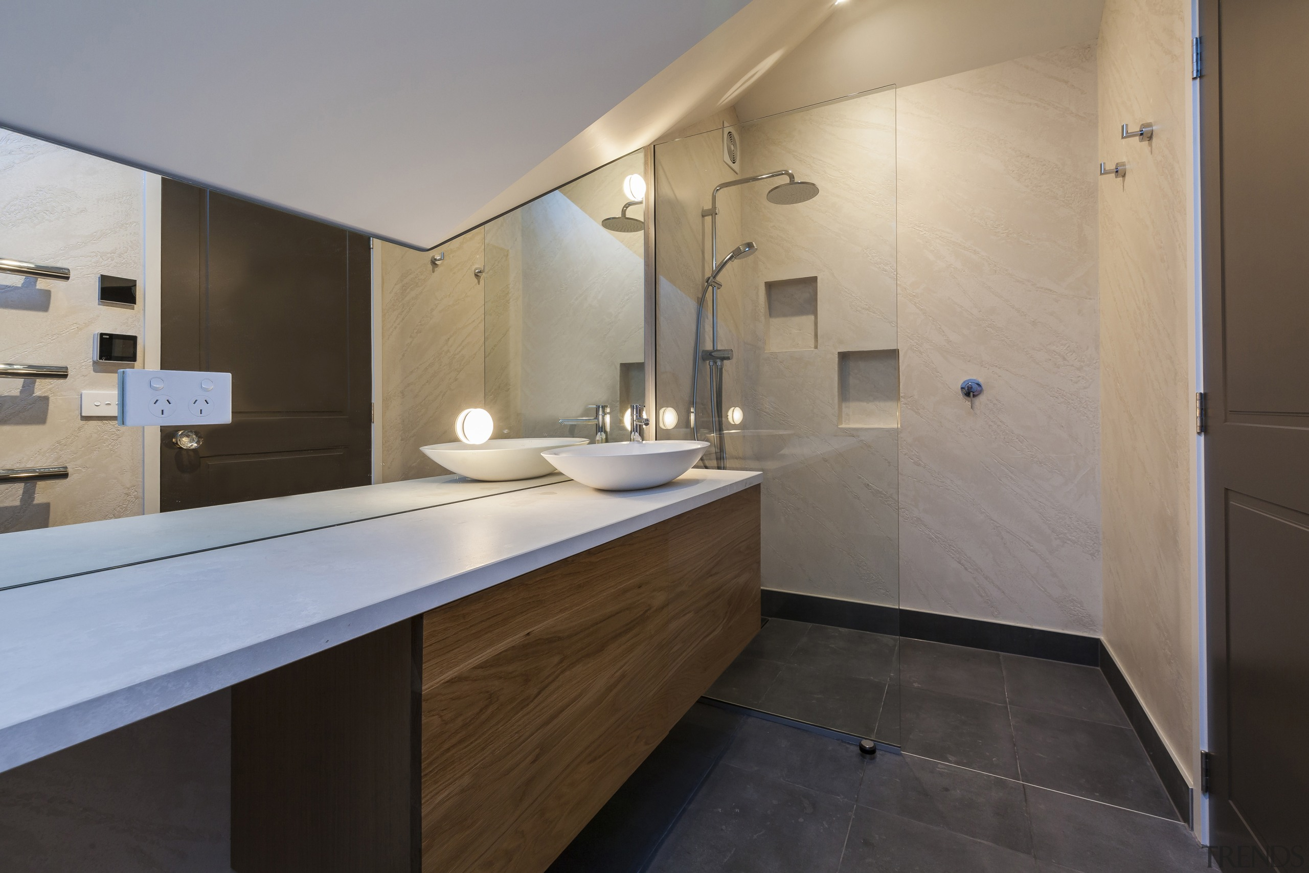The contemporary family bathroom is informed by the