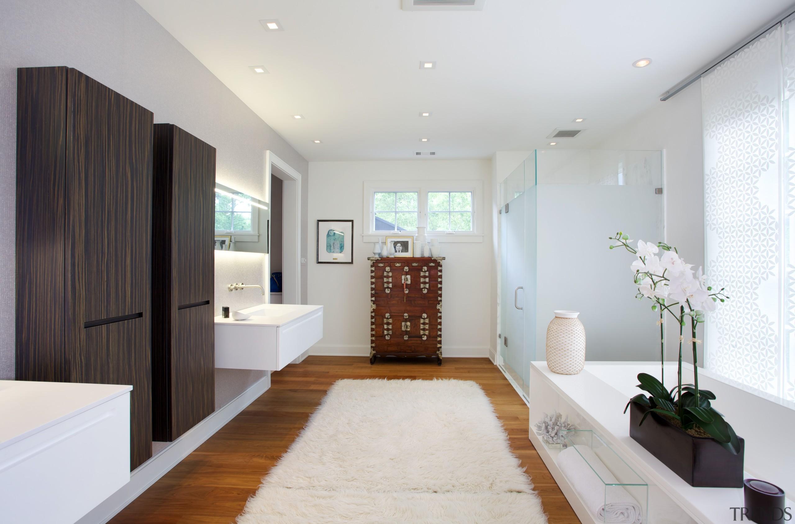 This master bathroom, designed by Nestor Santa-Cruz, continues bathroom, ceiling, floor, home, interior design, living room, real estate, room, white, gray
