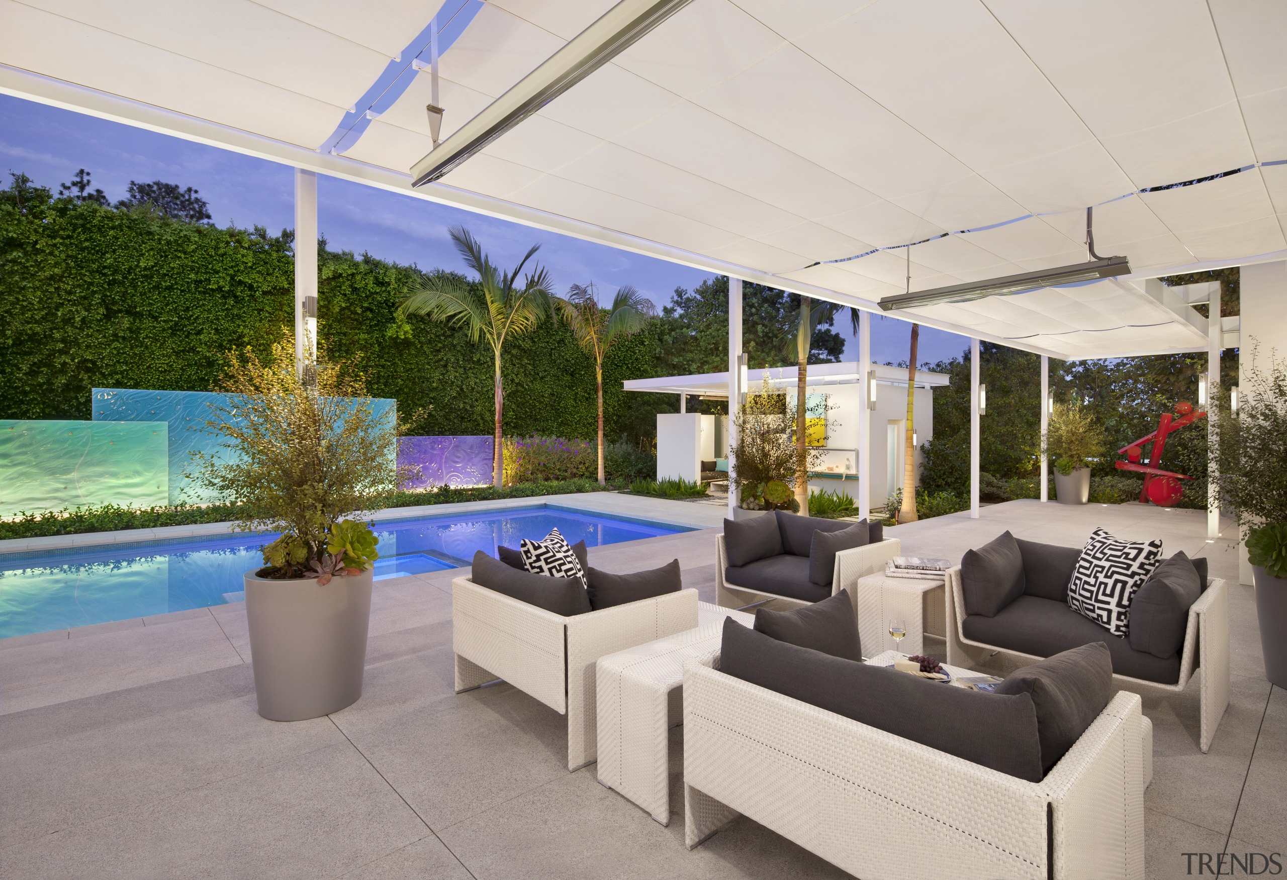 View of the pool and patio areas.  canopy, estate, home, house, interior design, outdoor structure, patio, property, real estate, gray