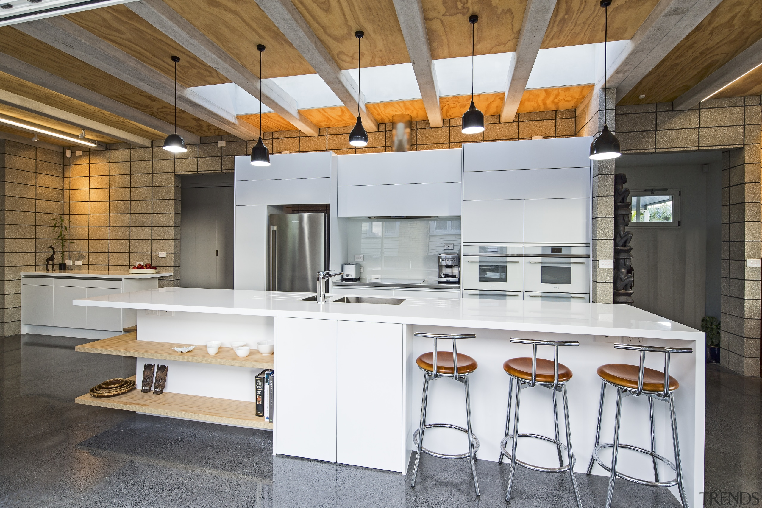 The beamed ceiling and long skylight give a architecture, ceiling, countertop, house, interior design, kitchen, real estate, white