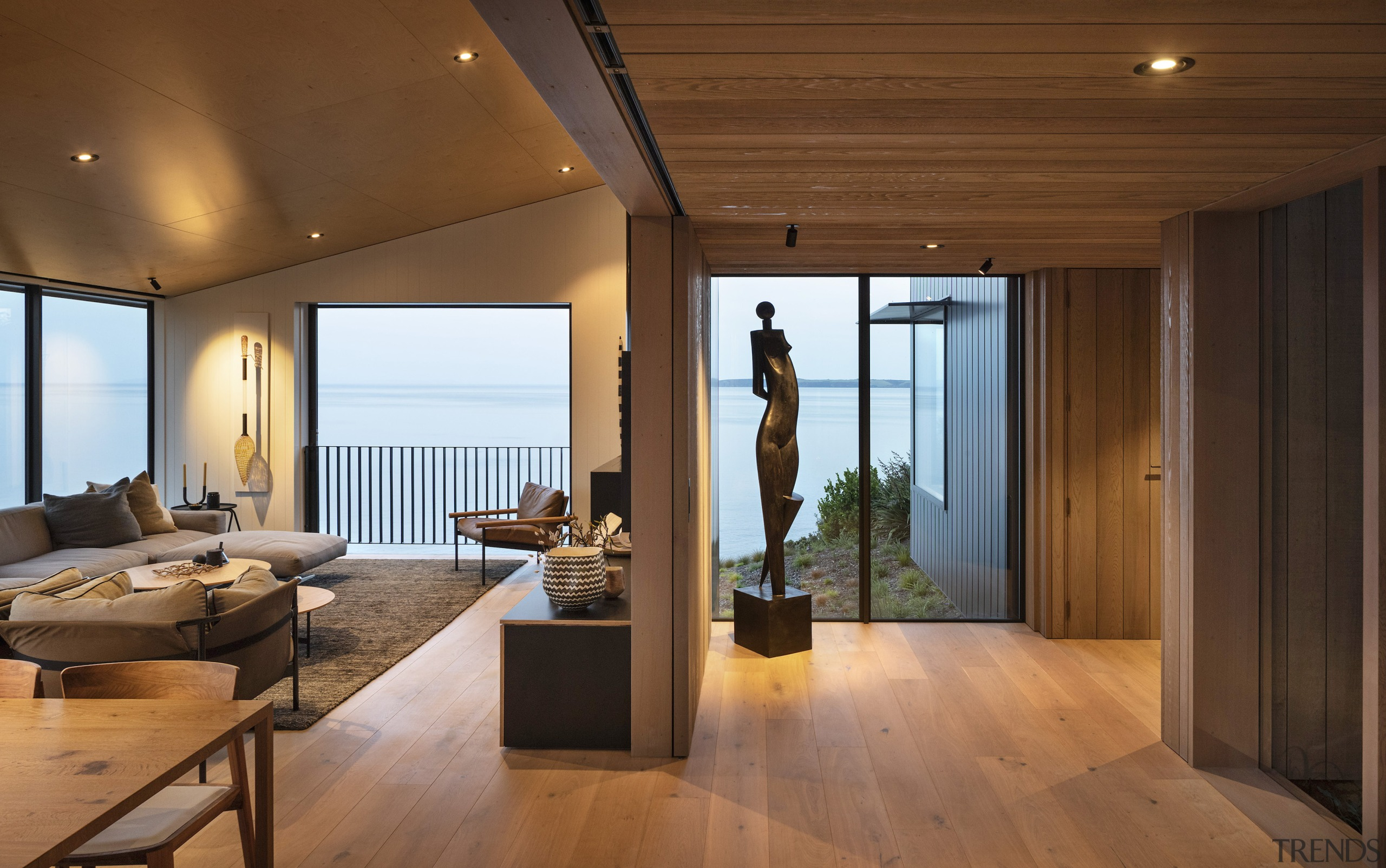Wood interior cladding and wood floors add to