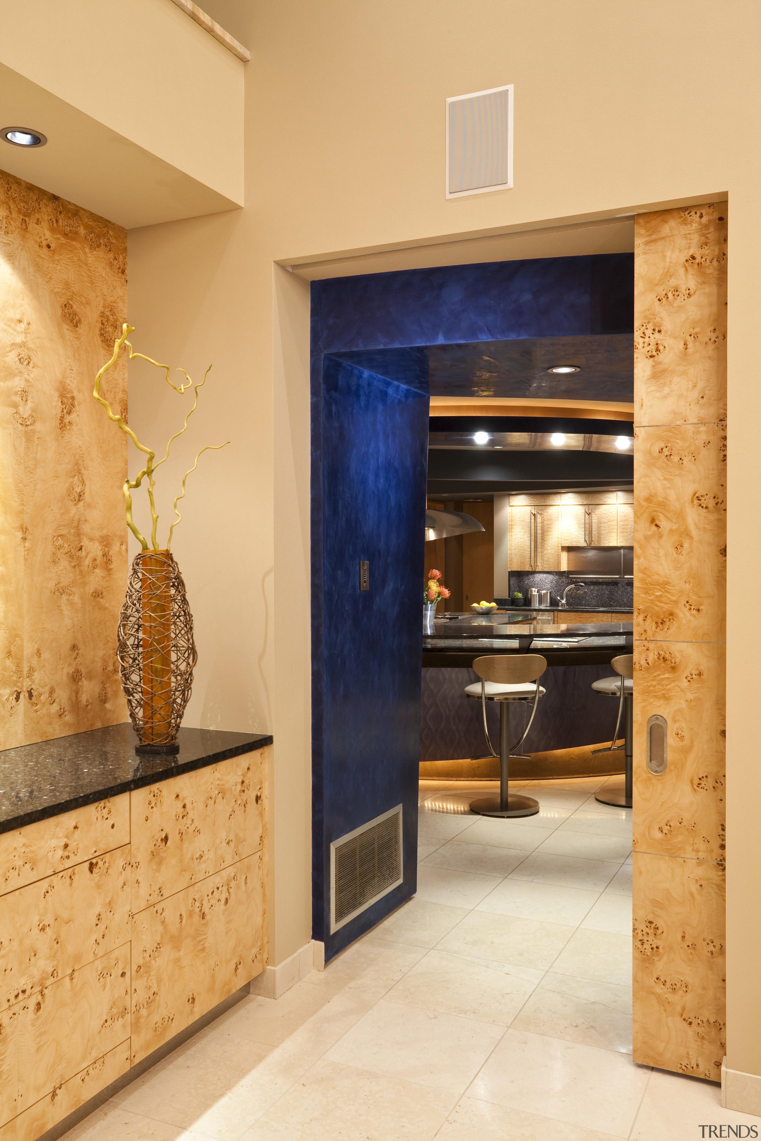 View of a kitchen which features a granite door, interior design, lobby, orange