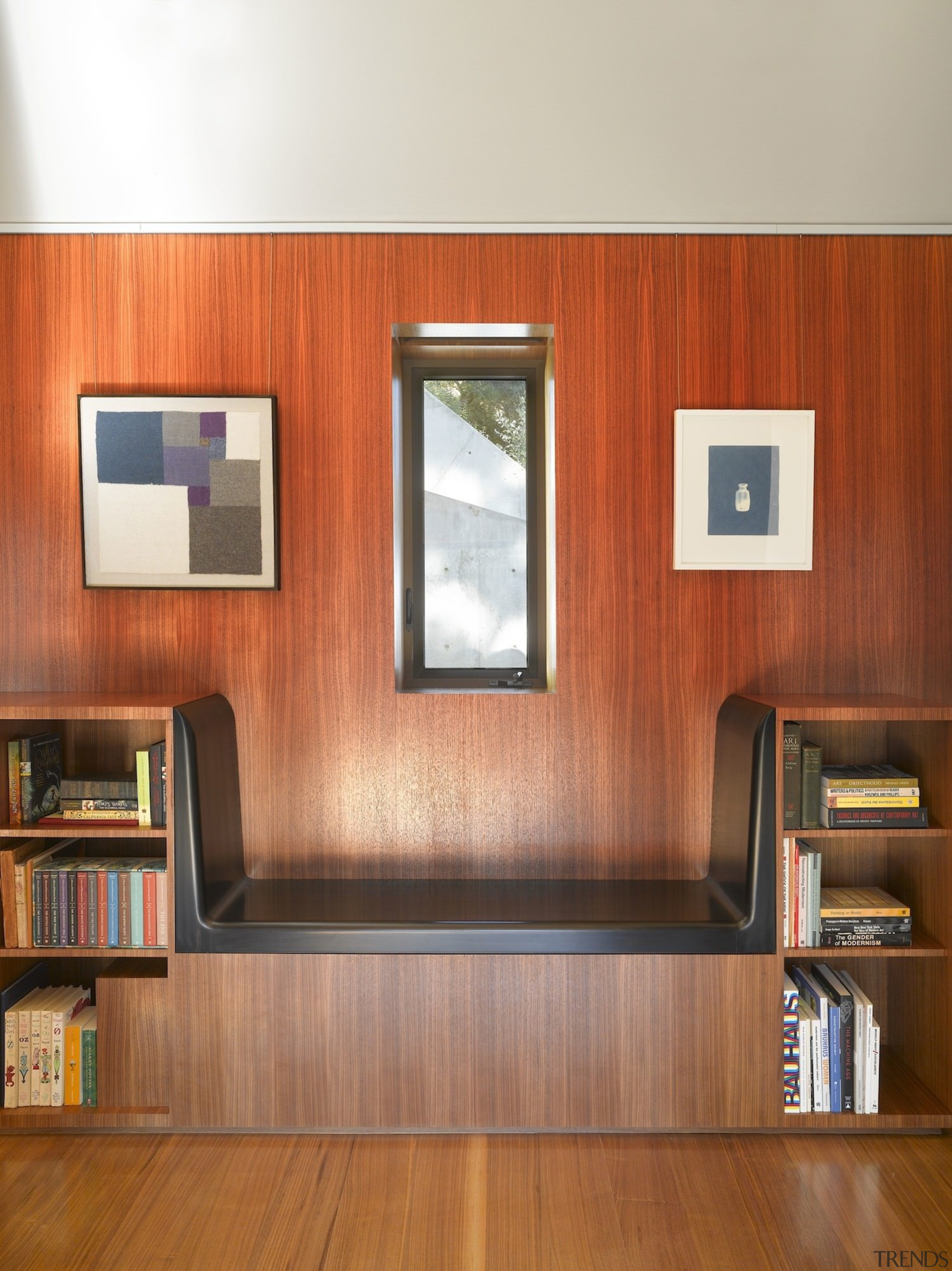 This window is perfectly framed by the seat bookcase, cabinetry, floor, flooring, furniture, hardwood, interior design, laminate flooring, shelf, shelving, wall, wood, wood flooring, wood stain, brown