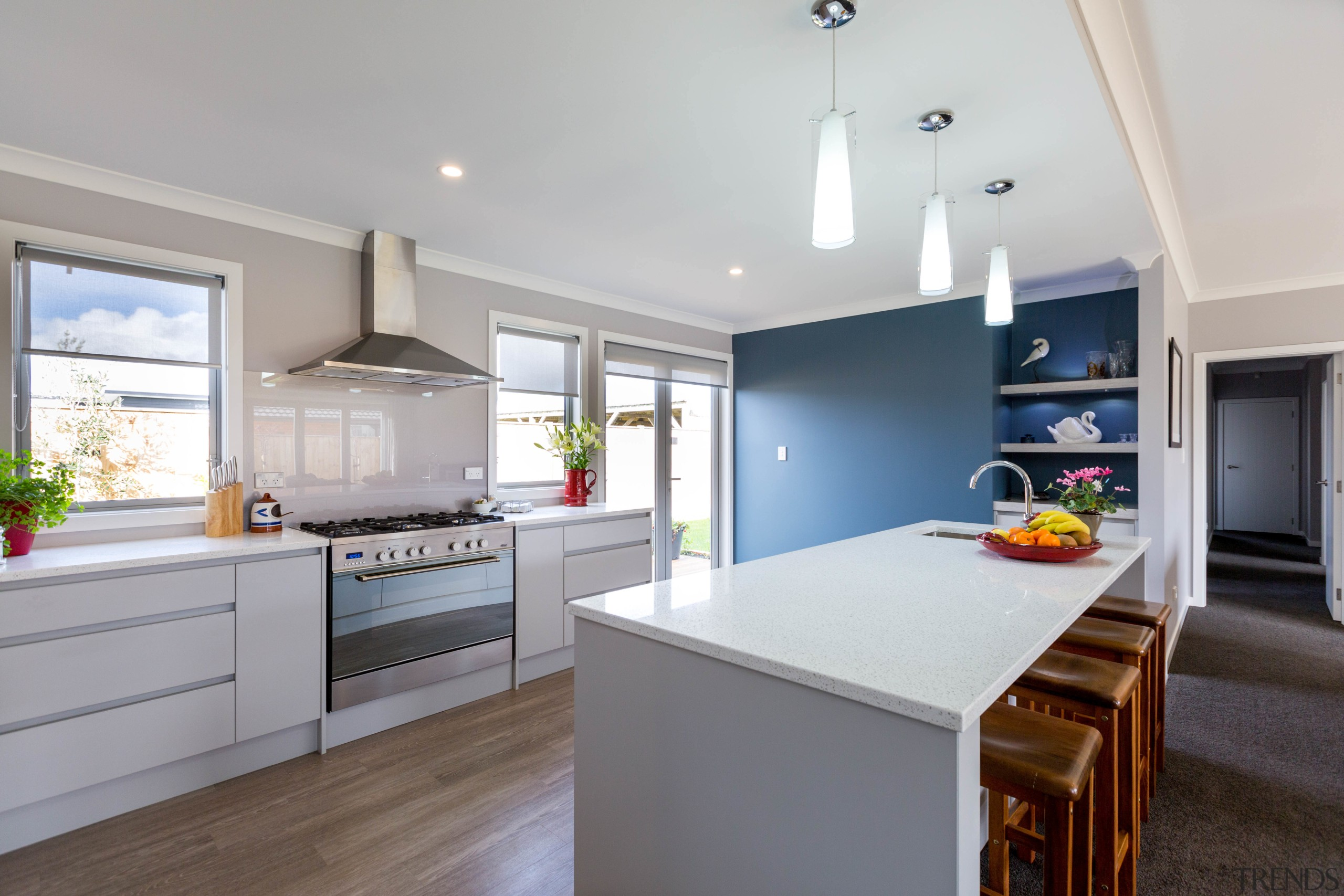 A feature wall in a smoky grey-blue shade countertop, cuisine classique, interior design, kitchen, real estate, room, gray