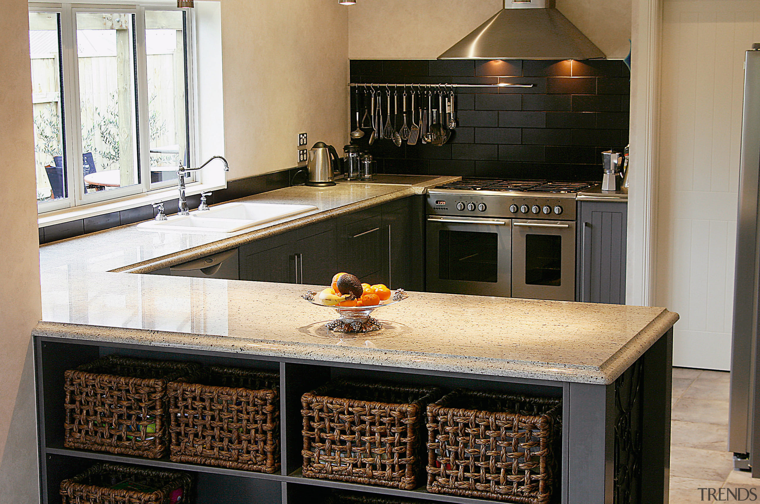 A view of a kitchen designed by Pauline countertop, cuisine classique, flooring, home appliance, kitchen, black