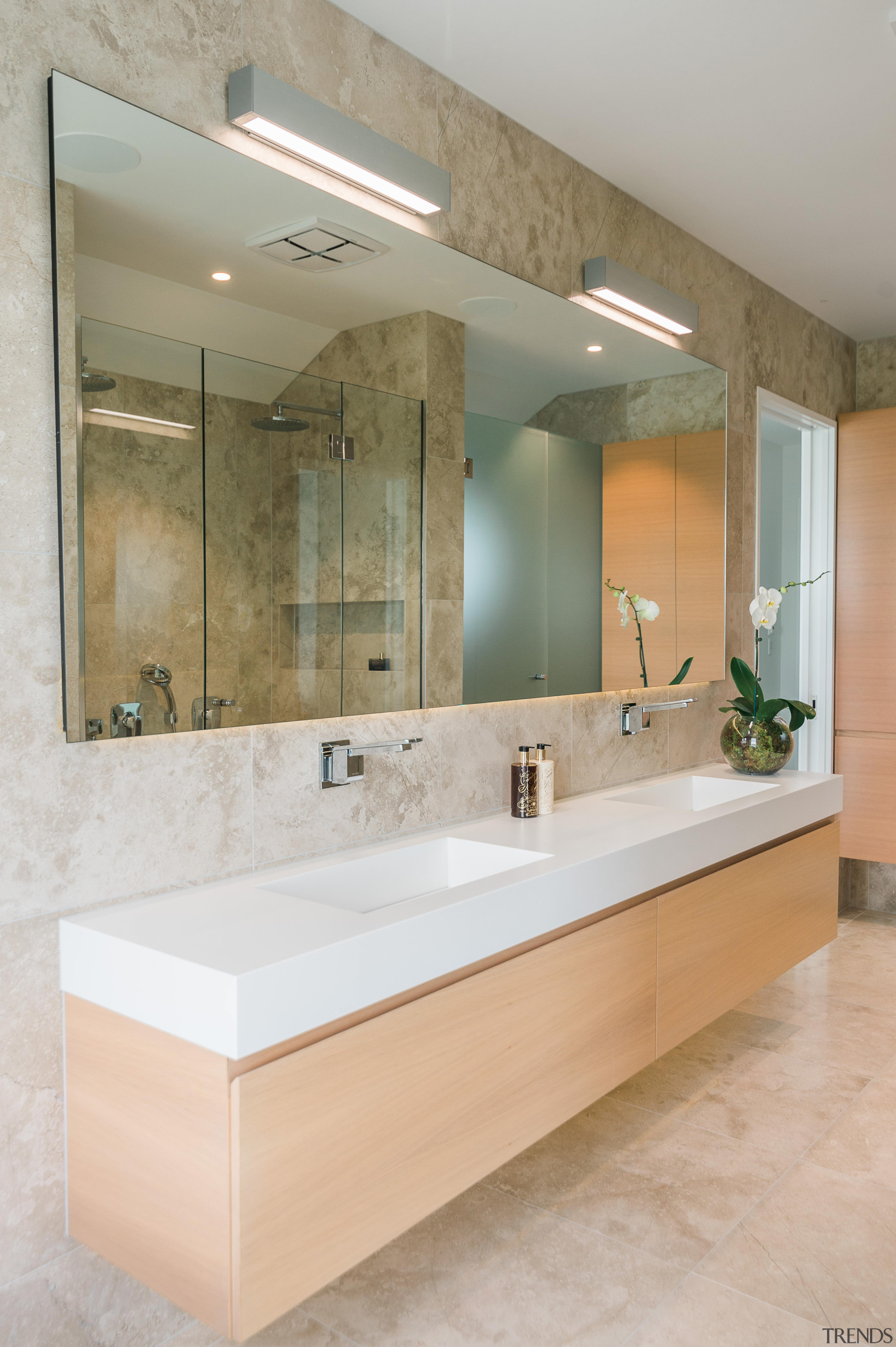 The long mirror in this bathroom has a bathroom, interior design, room, sink, tap, gray