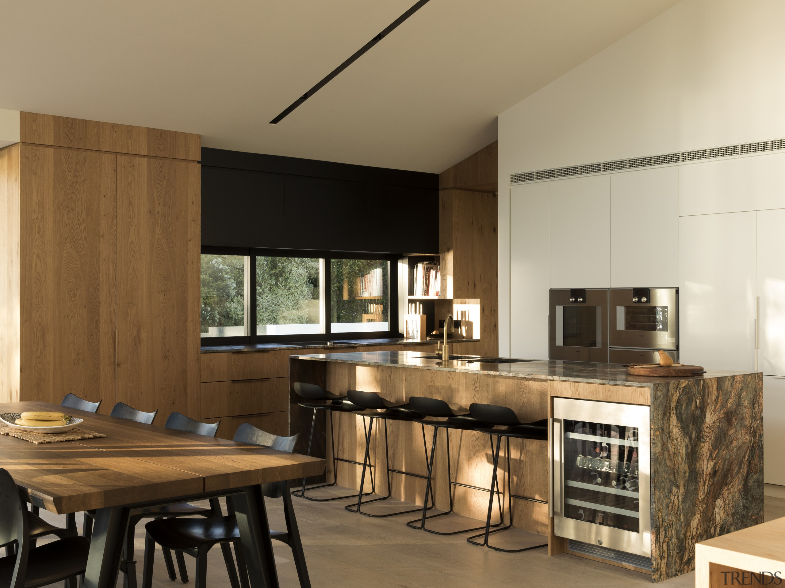 This slender marble benchtop overhangs the front of countertop, cuisine classique, interior design, kitchen, brown