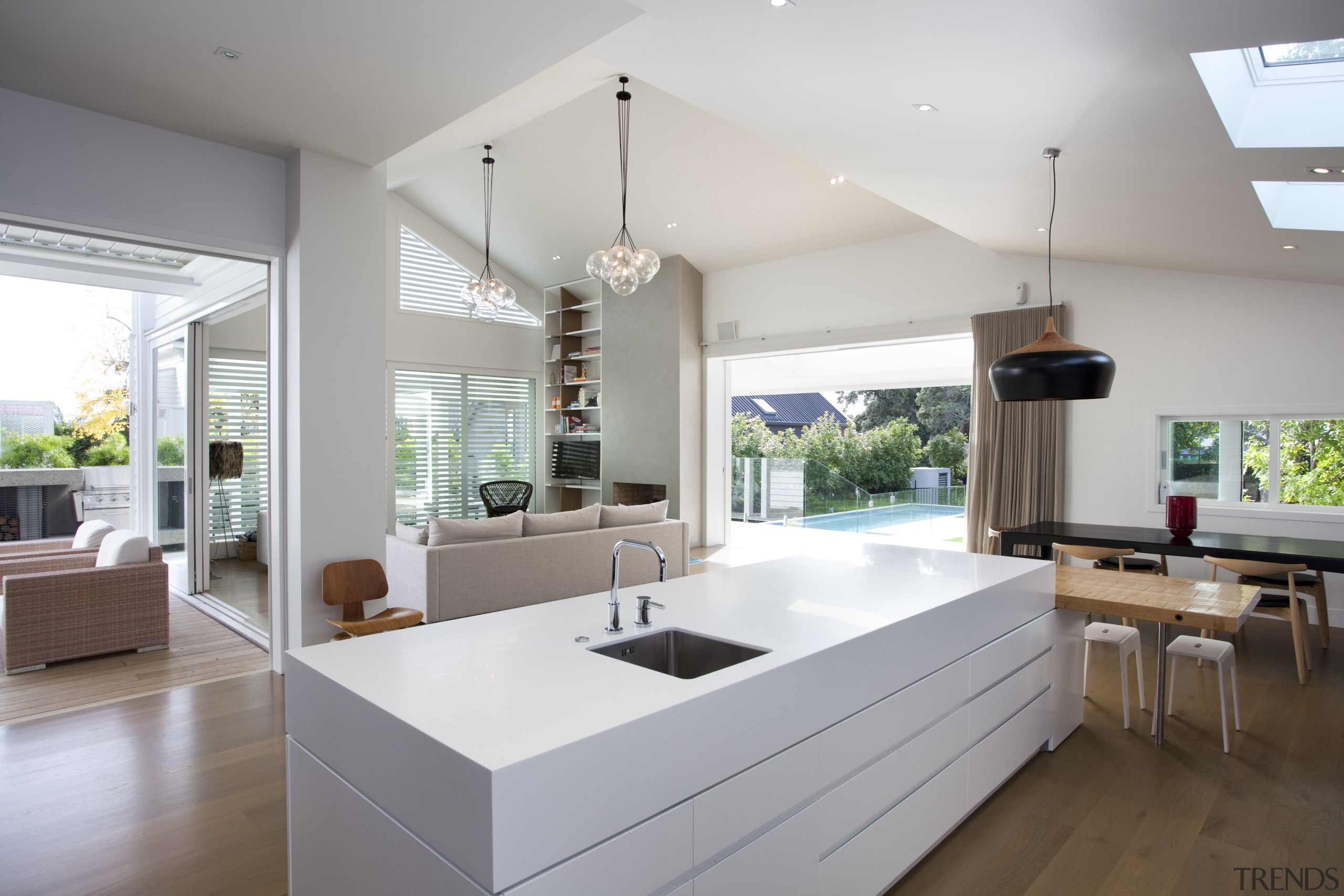 This kitchen and living room in a renovated architecture, countertop, house, interior design, kitchen, living room, real estate, gray, white