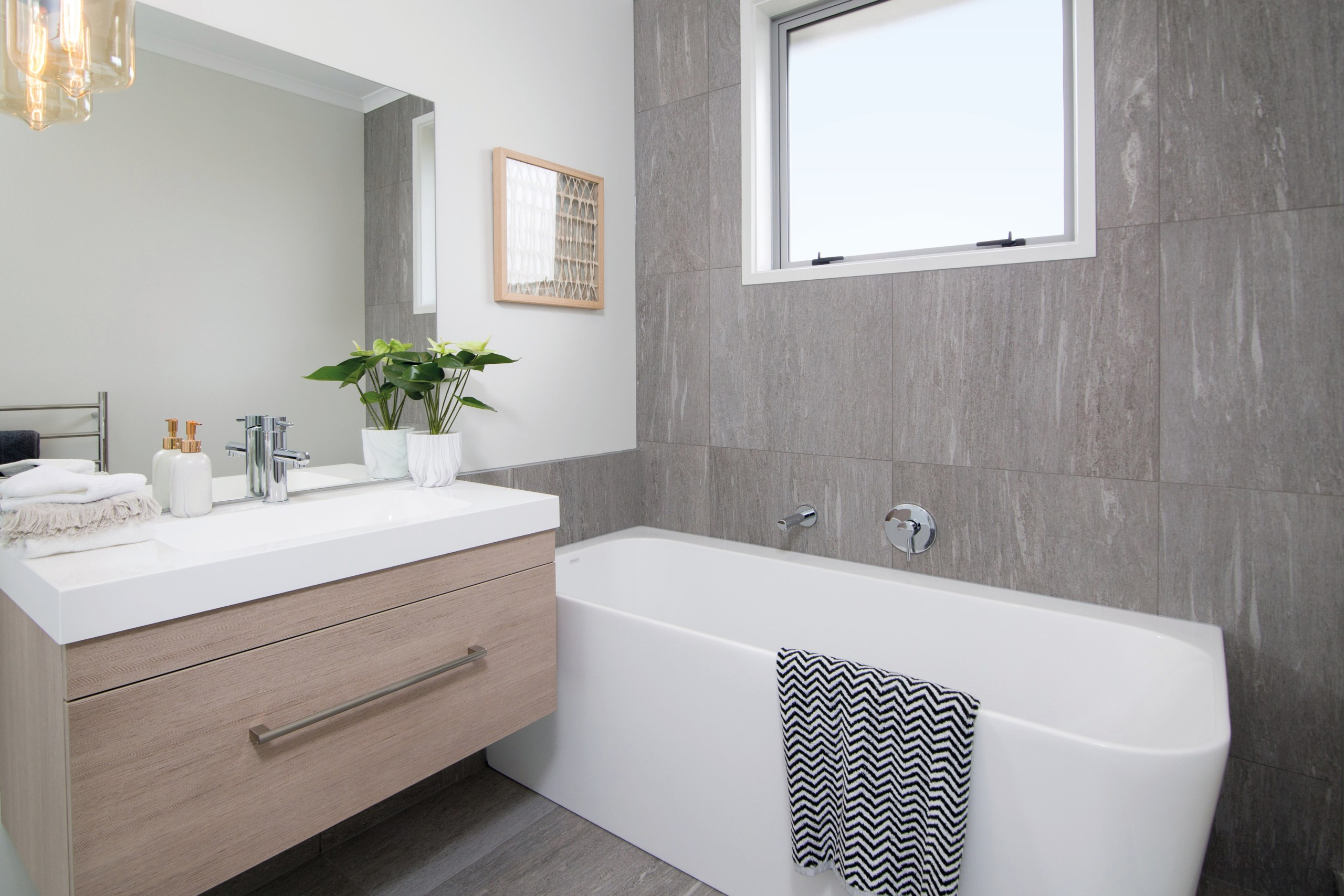 Tilework with the look of slate works well bathroom, bathroom accessory, bathroom cabinet, floor, home, interior design, room, sink, tap, tile, gray, white