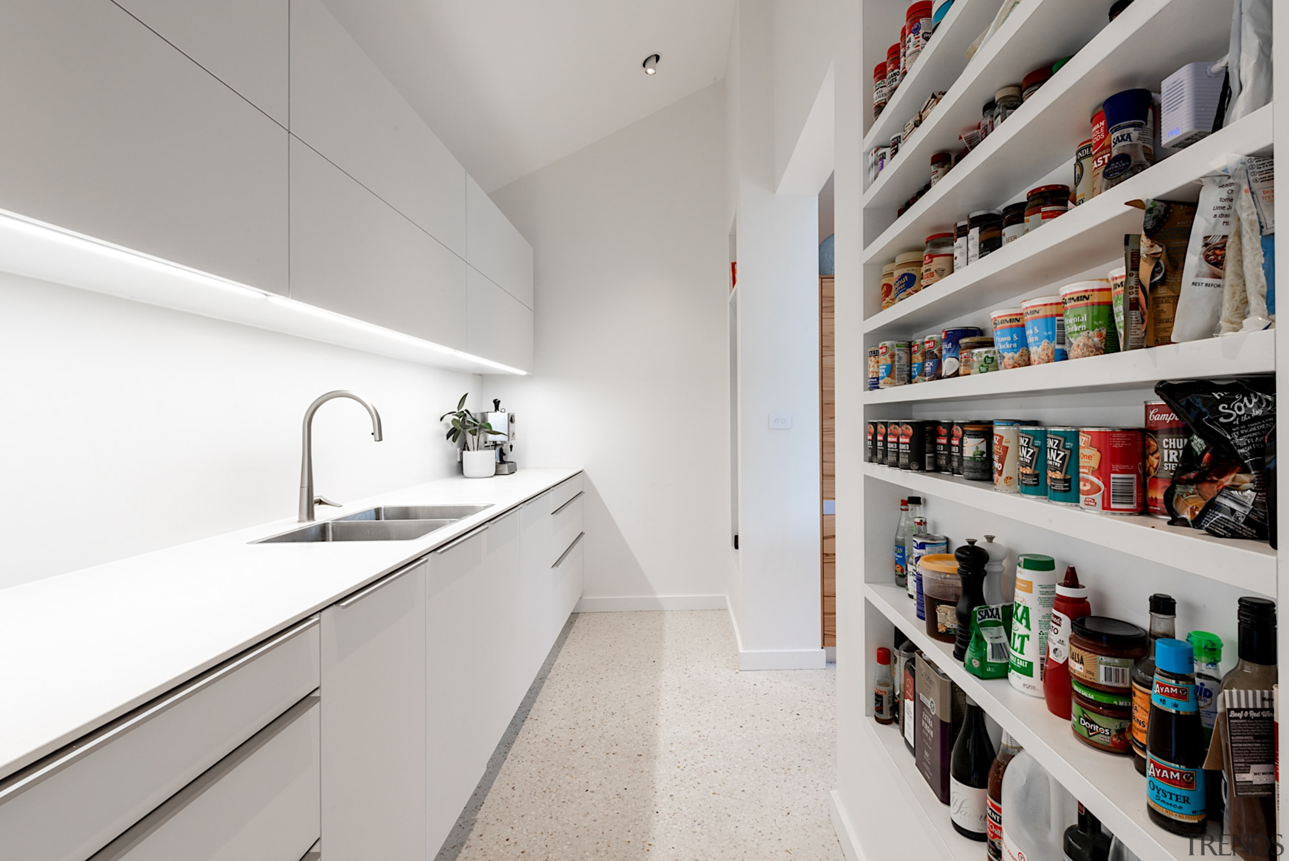 The well equipped pantry has two entries, one