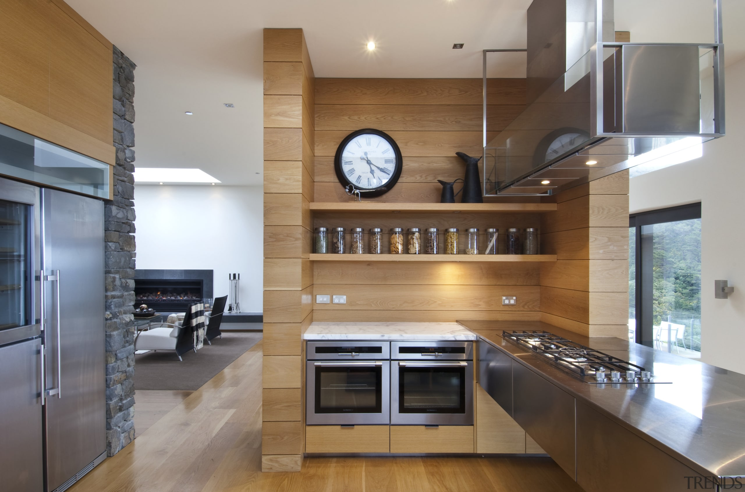 Raised floor kitchen. Stainless steel Binova cooktop. American cabinetry, countertop, cuisine classique, flooring, hardwood, interior design, kitchen, real estate, wood flooring, gray, brown