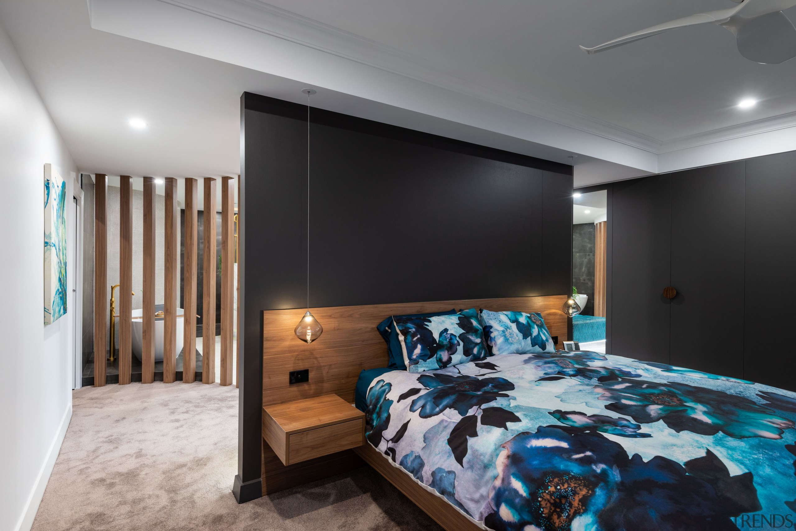 Dark wall and cabinet tones accentuate the warmth architecture, bed, bed frame, bed sheet, bedding, bedroom, building, ceiling, floor, furniture, hardwood, home, house, interior design, linens, loft, mattress, property, real estate, room, suite, wall, wood flooring, gray, black