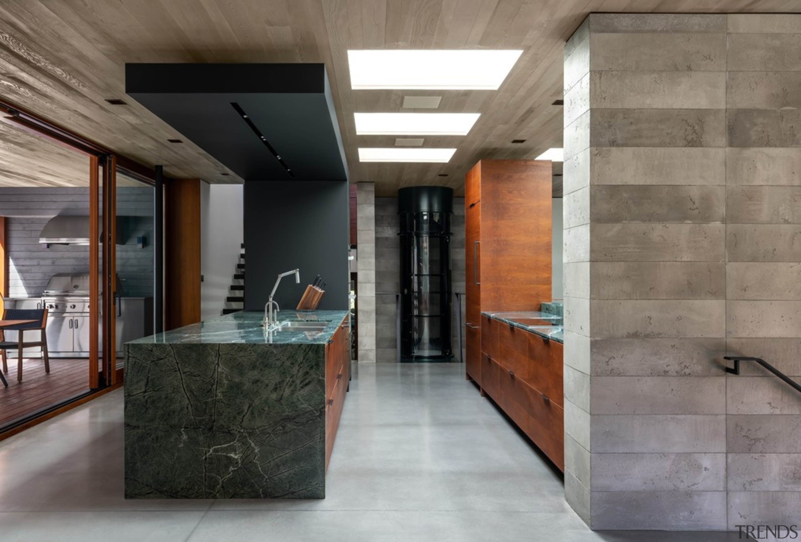 The timeless kitchen is naturally lit with a architecture, building, ceiling, concrete, floor, flooring, furniture, home, house, interior design, lobby, loft, property, room, space, tile, wall, gray, taps, tapware