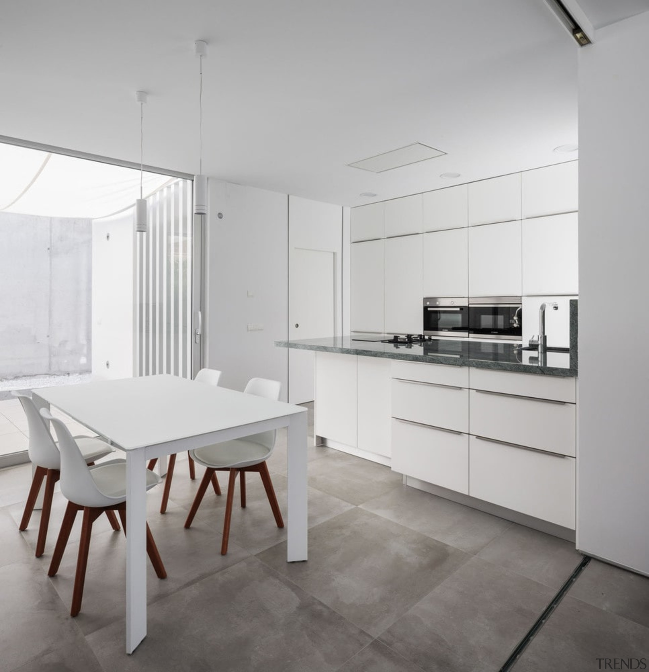 The kitchen features a similar white aesthetic found architecture, countertop, floor, flooring, interior design, kitchen, table, gray