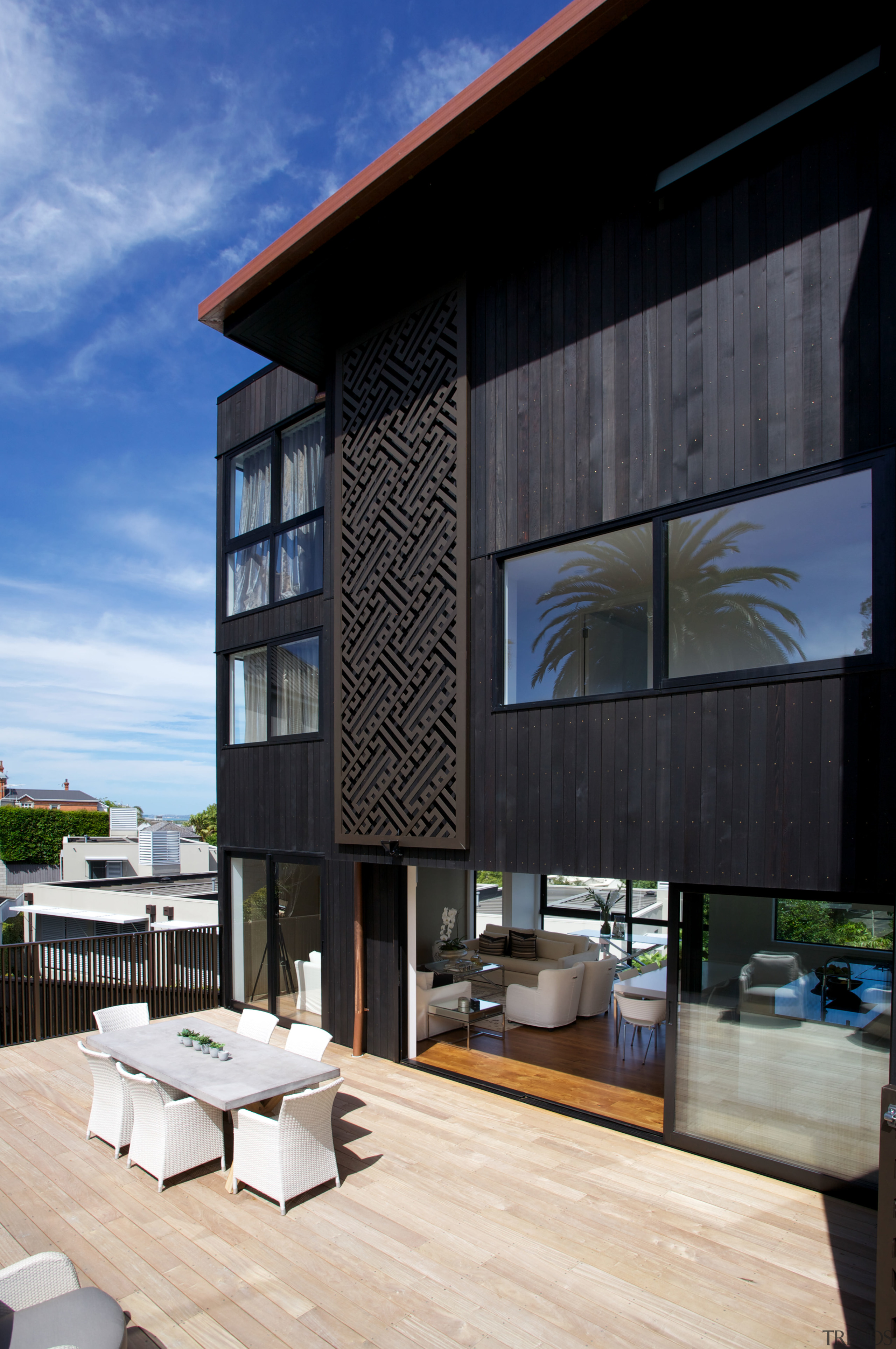 This contemporary Parnell townhouse, designed by Paul Izzard, architecture, building, condominium, facade, home, house, interior design, real estate, black