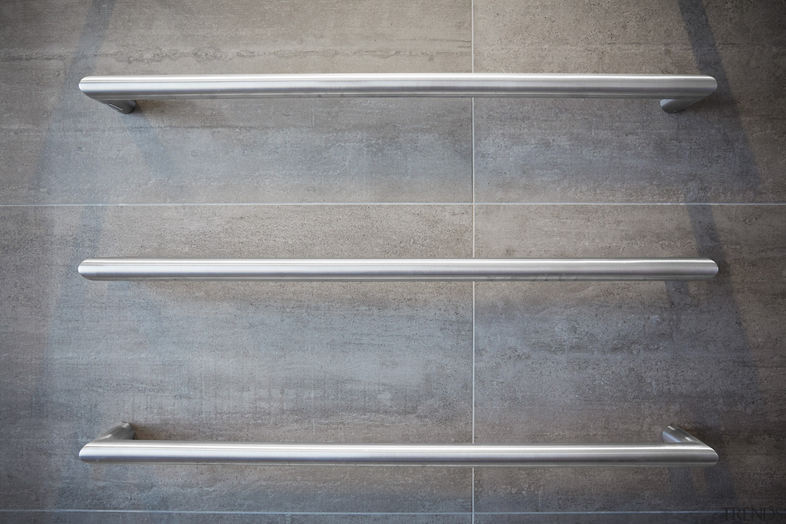 Heated towel rails provide an industrial touch in product design, steel, wood, gray
