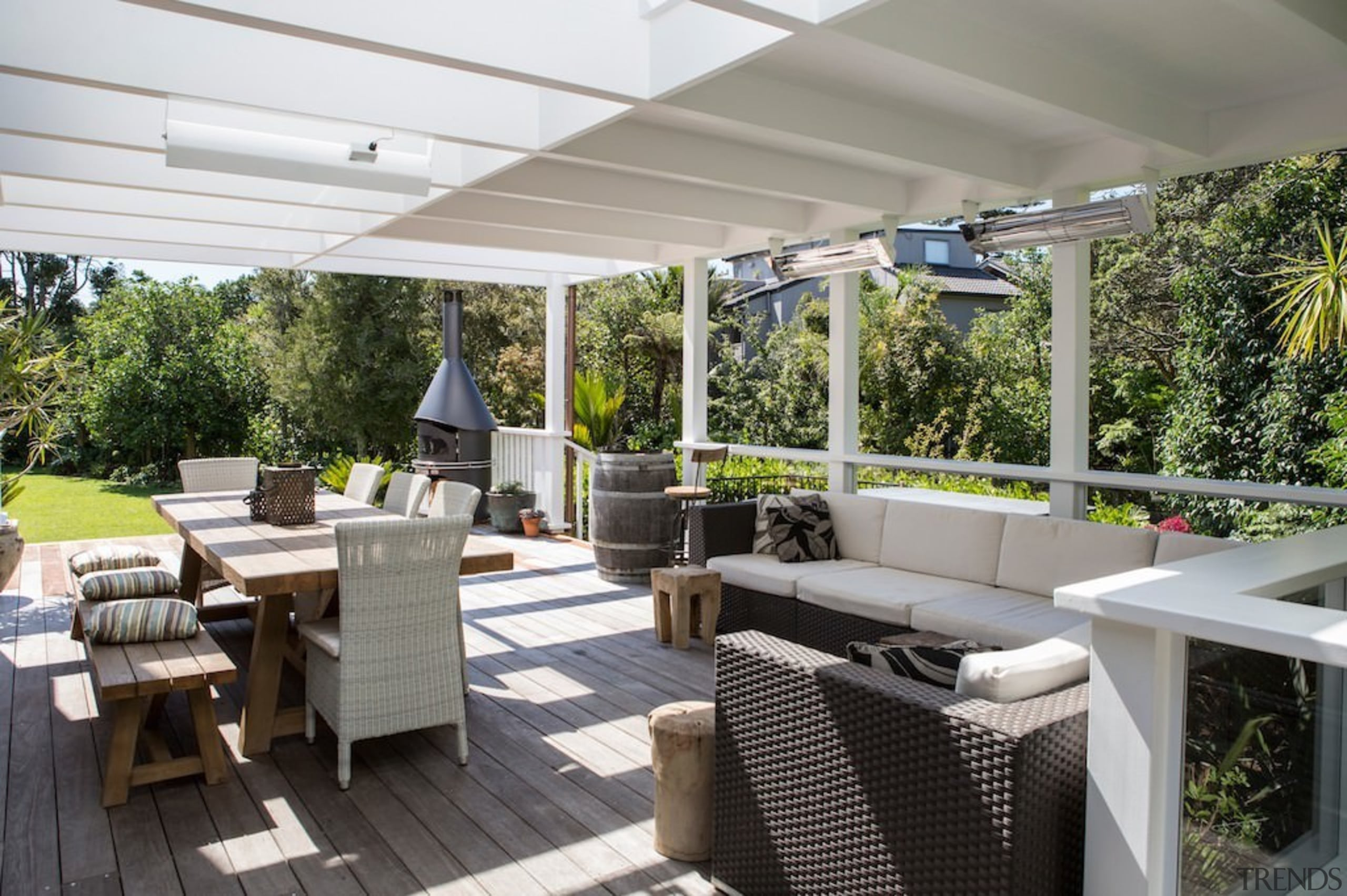 This outdoor space gives a feeling of living interior design, outdoor structure, patio, property, real estate, roof, gray