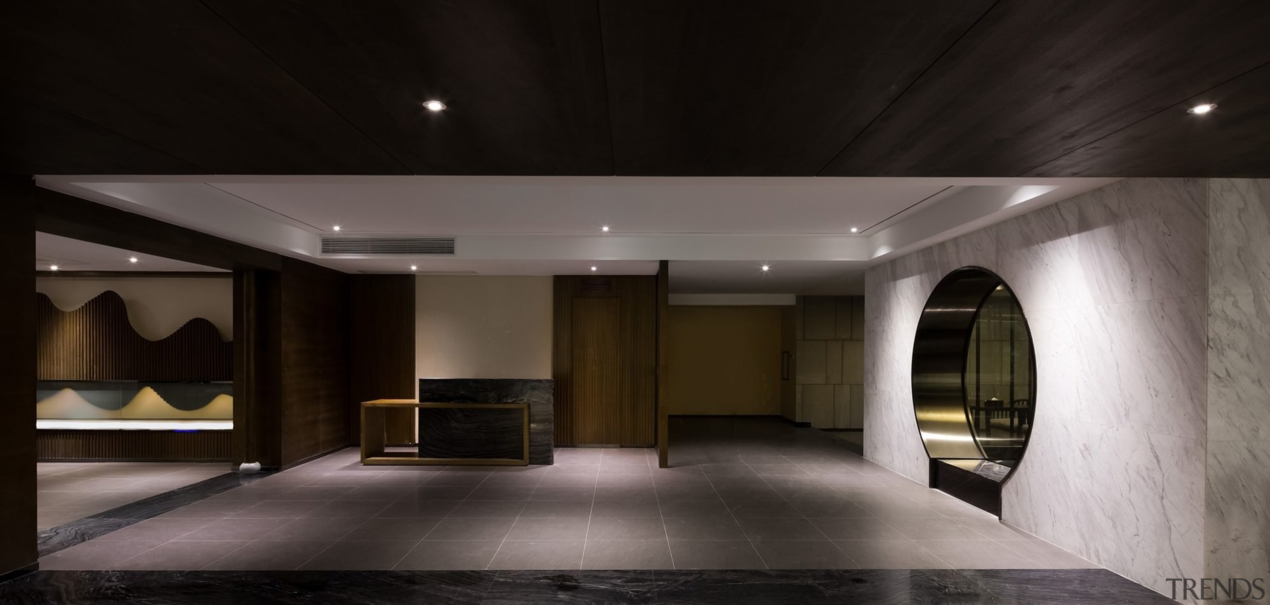 This circular doorway leads you through to the architecture, ceiling, interior design, lighting, lobby, black, gray