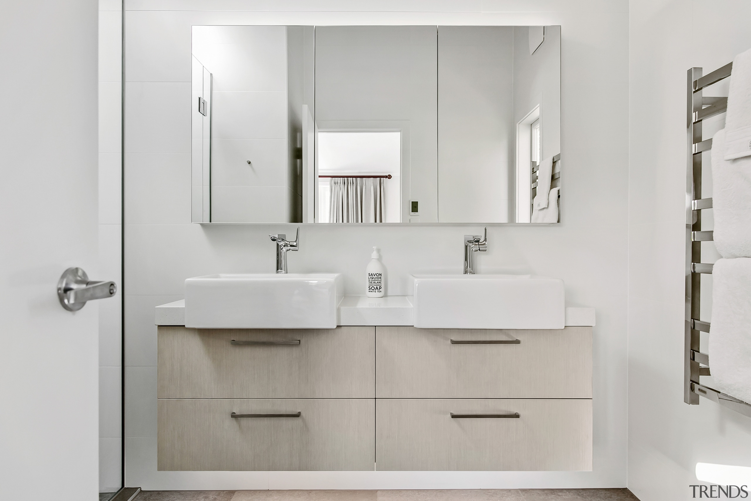 Large vanity mirrors add this bathroom's overall sense