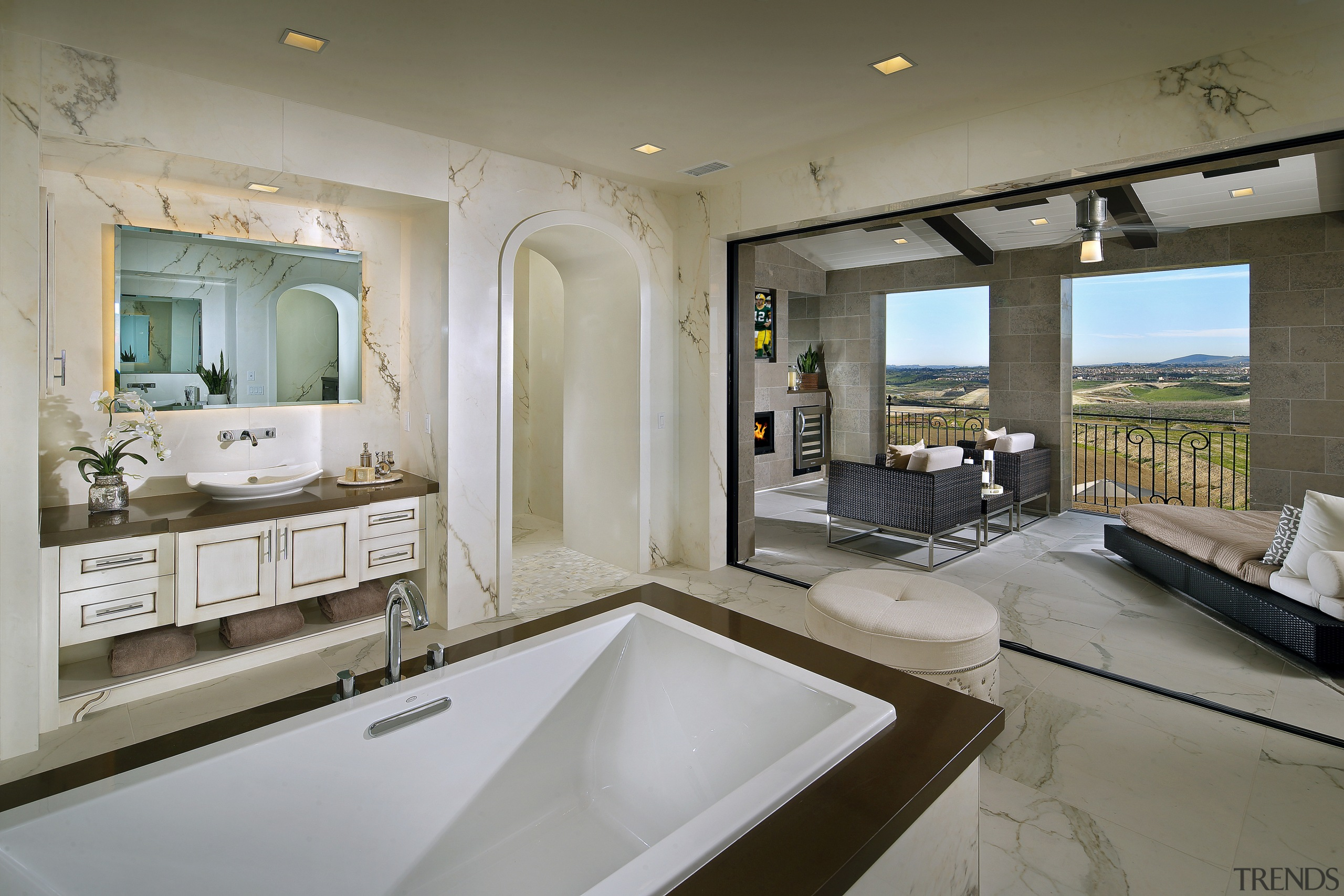 Stacking glass doors separate the master bathroom from bathroom, countertop, estate, home, interior design, real estate, room, gray
