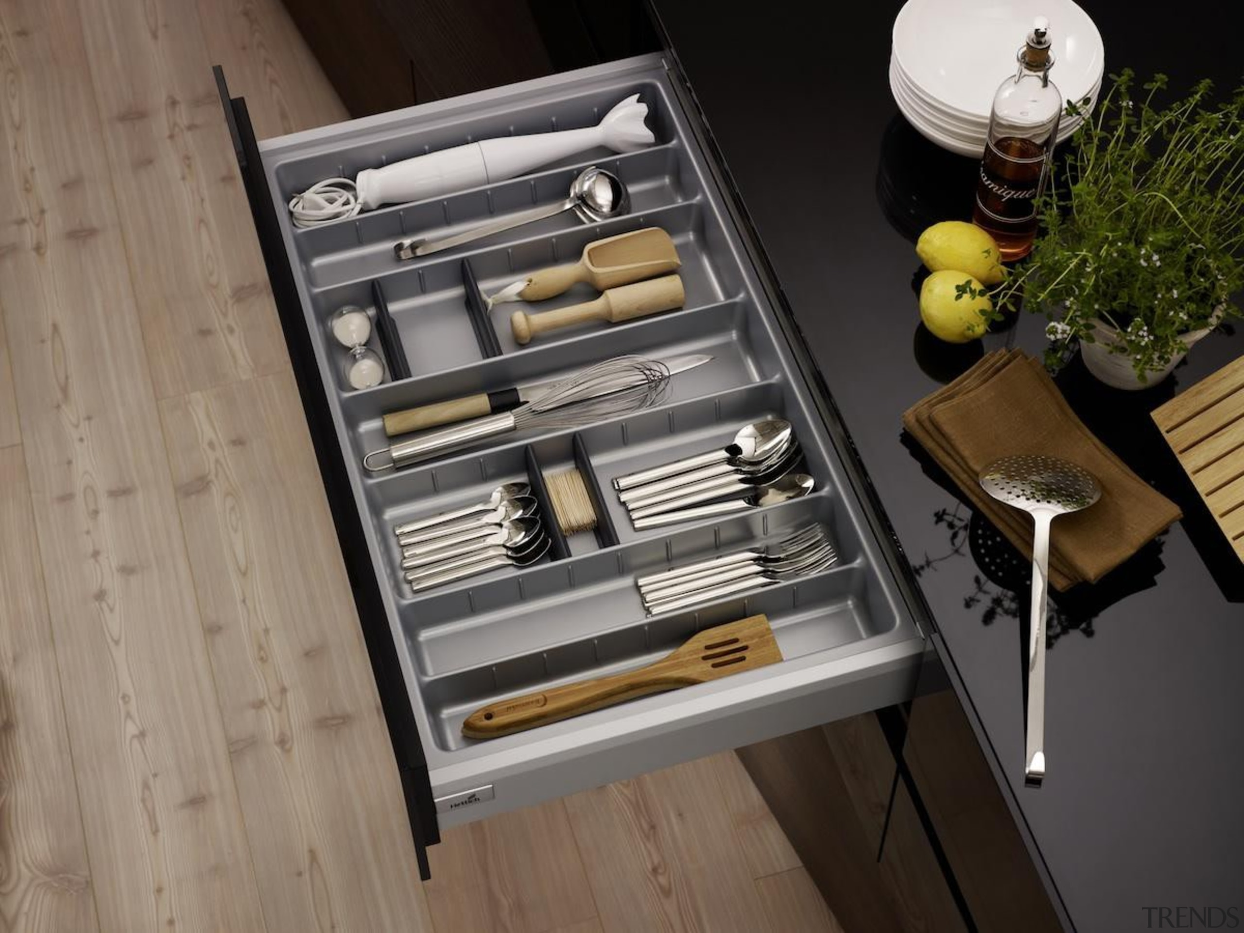 A gentle press on the front panel of drawer, furniture, table, black, gray