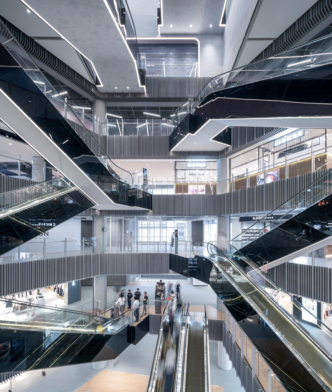 The renovation's second plaza has a more industrial architecture, building, escalator, shimaoKokais studios, plaza