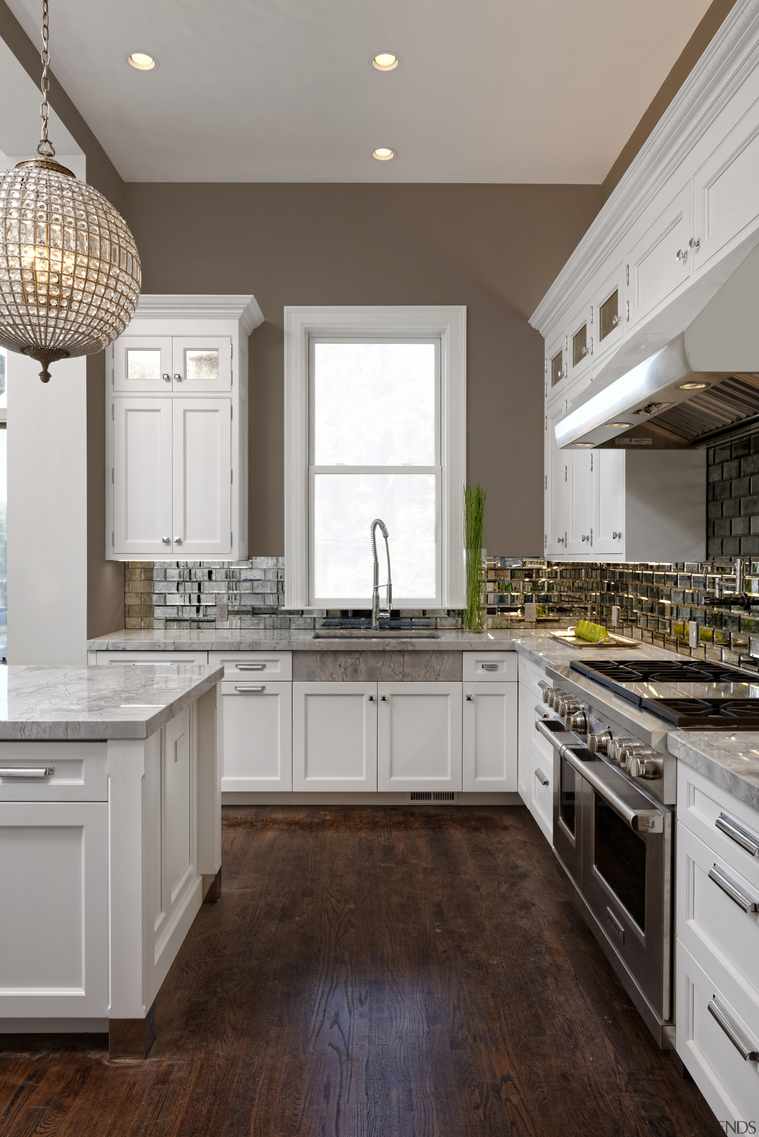 Wood floors and a taupe-coloured wall tone create cabinetry, countertop, cuisine classique, floor, flooring, hardwood, home, interior design, kitchen, room, wood flooring, gray, brown