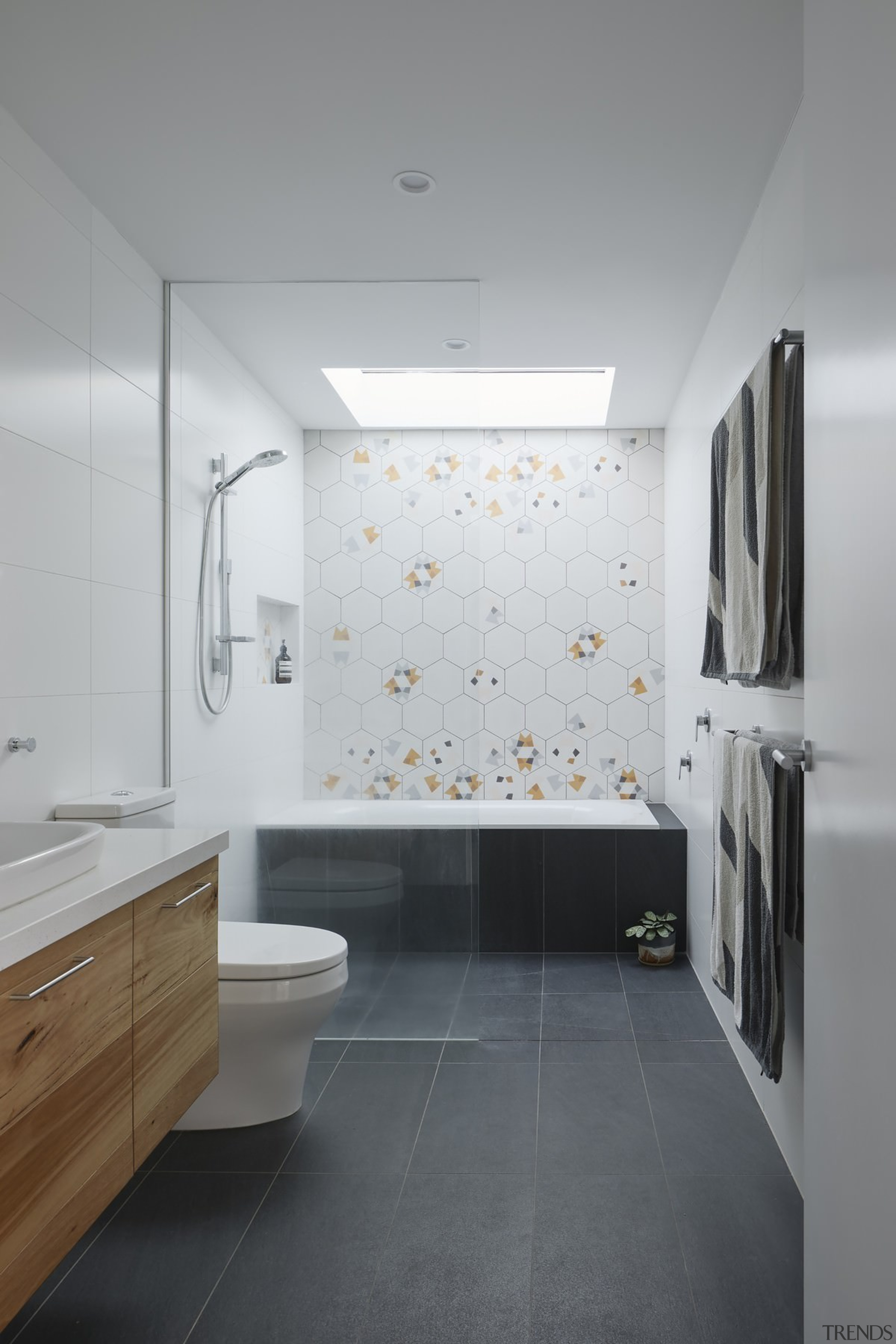 The bathroom features a large wet area - architecture, bathroom, bathroom accessory, bathroom cabinet, ceiling, daylighting, floor, flooring, interior design, product design, room, sink, tile, wall, gray