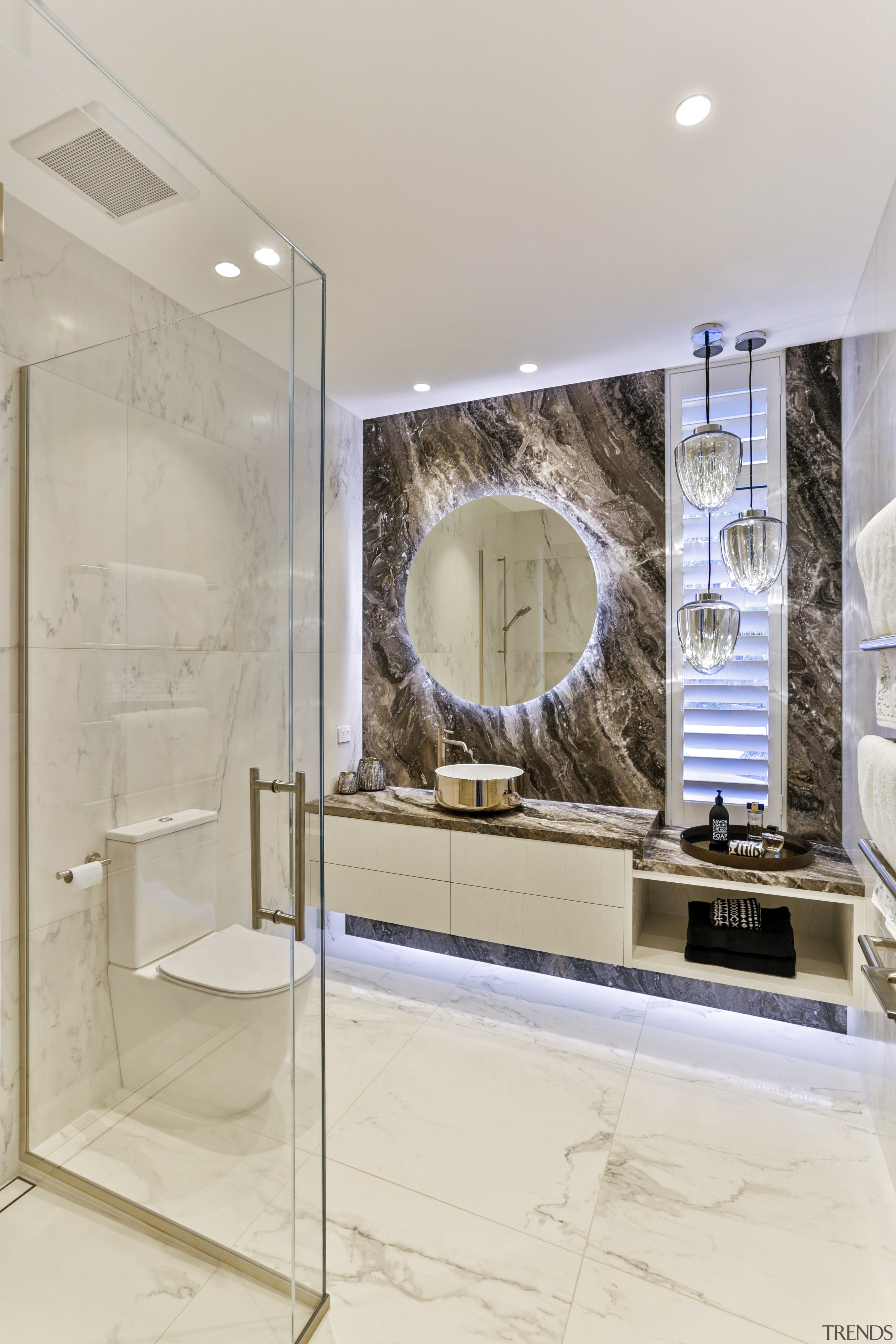 A large backlit mirror throws an eye-catching pattern gray