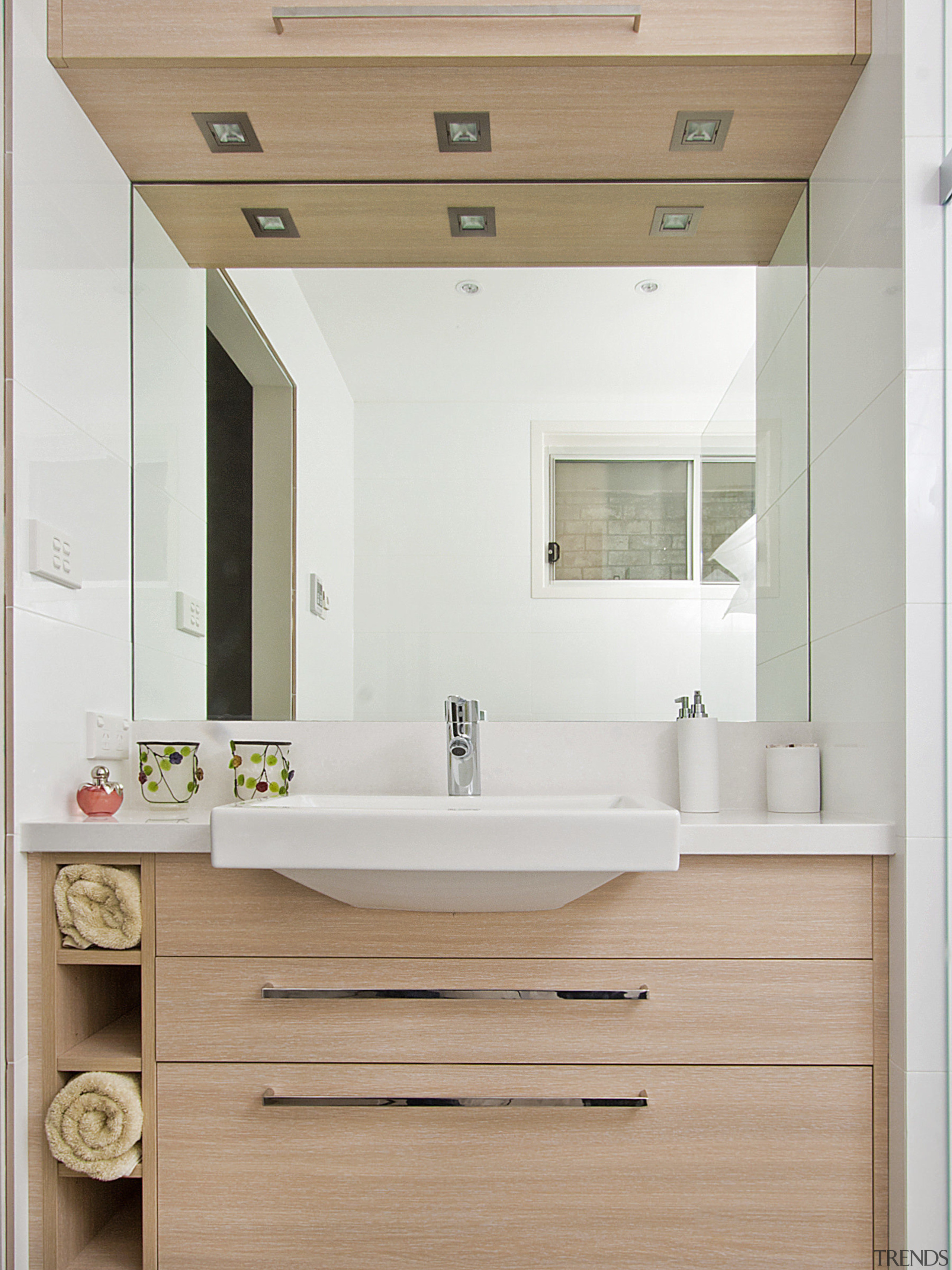 View of bathroom featuring wood floors, white bench bathroom, bathroom accessory, bathroom cabinet, cabinetry, interior design, product design, sink, white, gray, orange