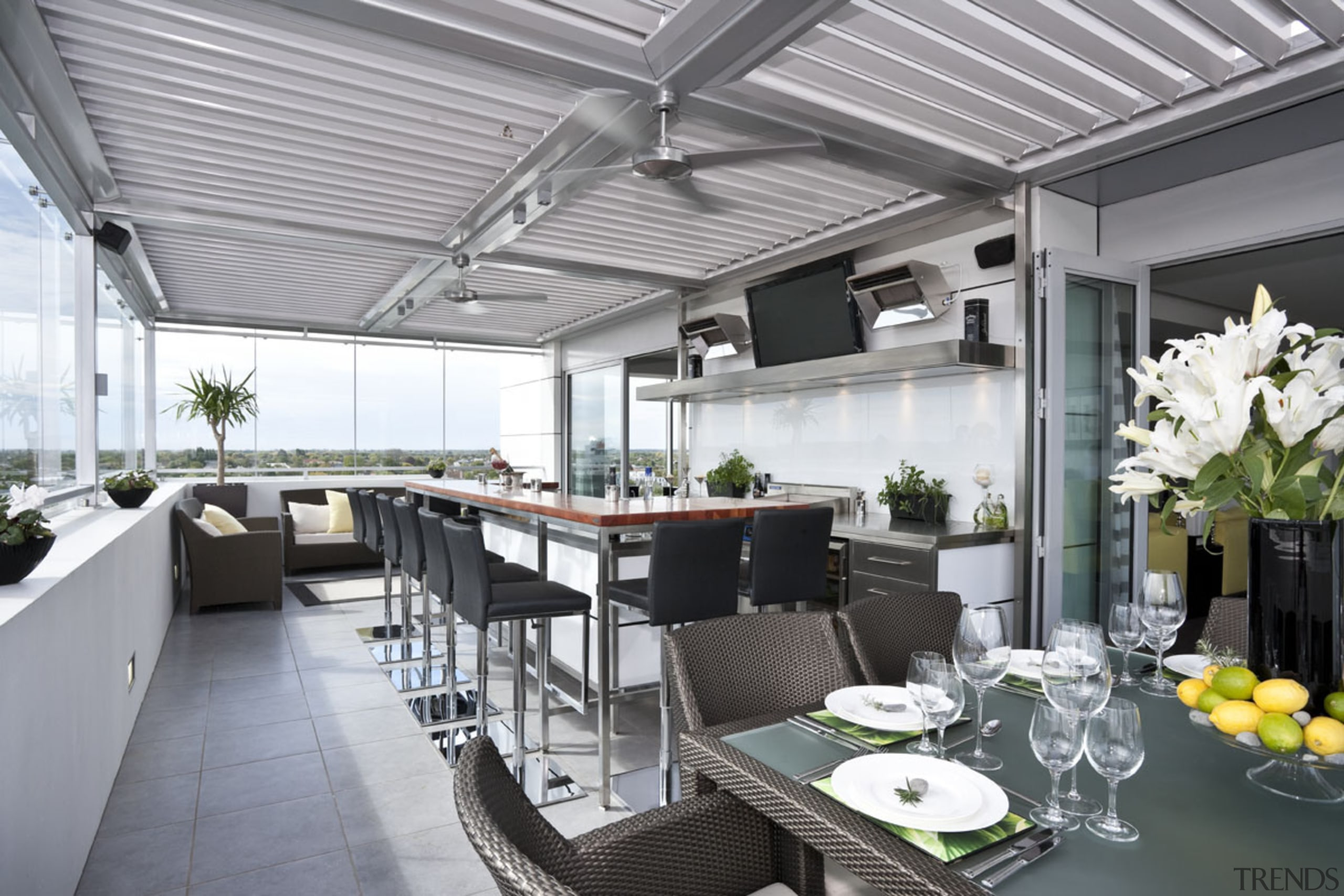 This outdoor kitchen space can be used interior design, patio, real estate, roof, gray