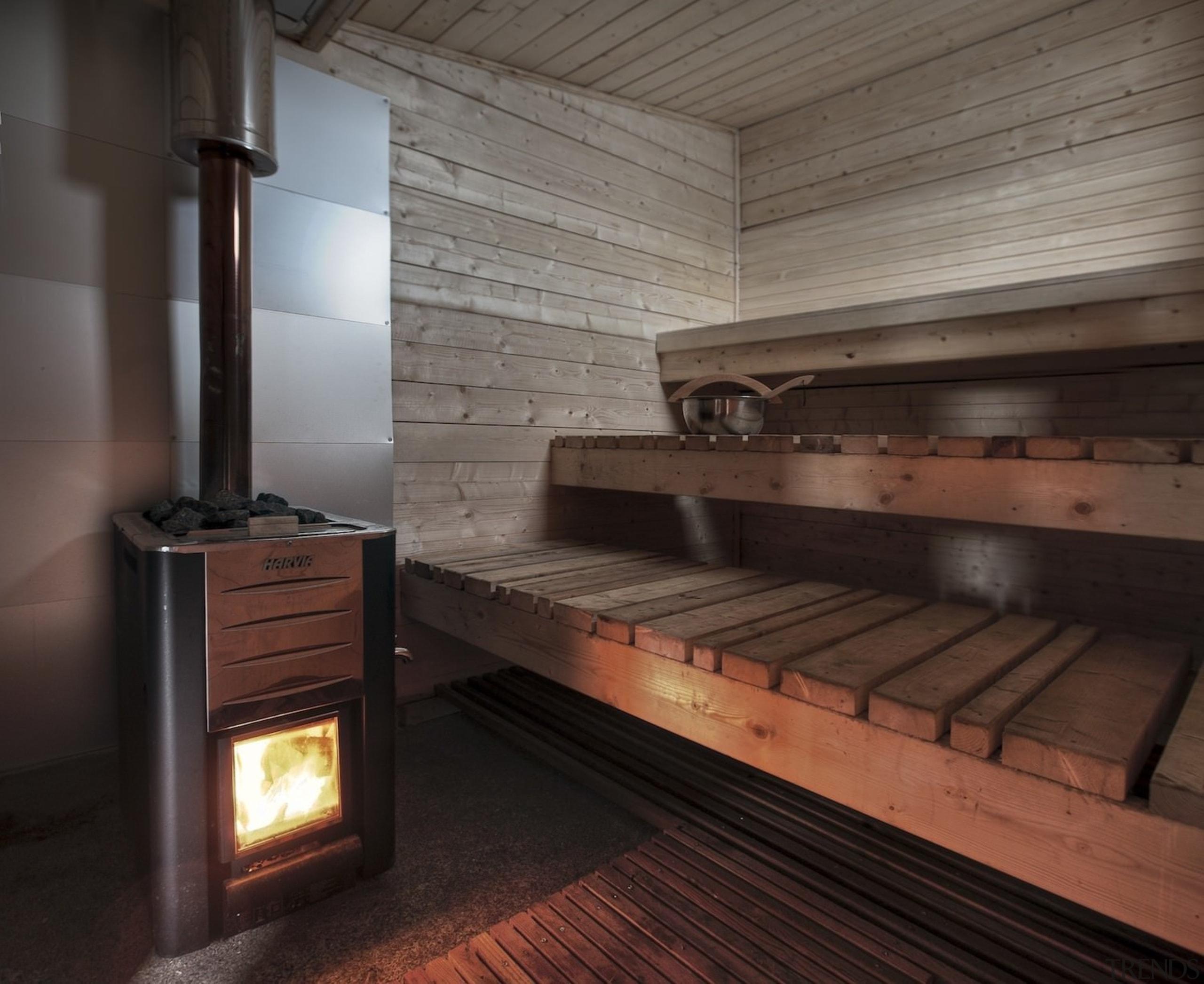 Architect: TYIN tegnestue ArchitectsPhotographer: Pasi Aalto / hearth, wood, black, gray