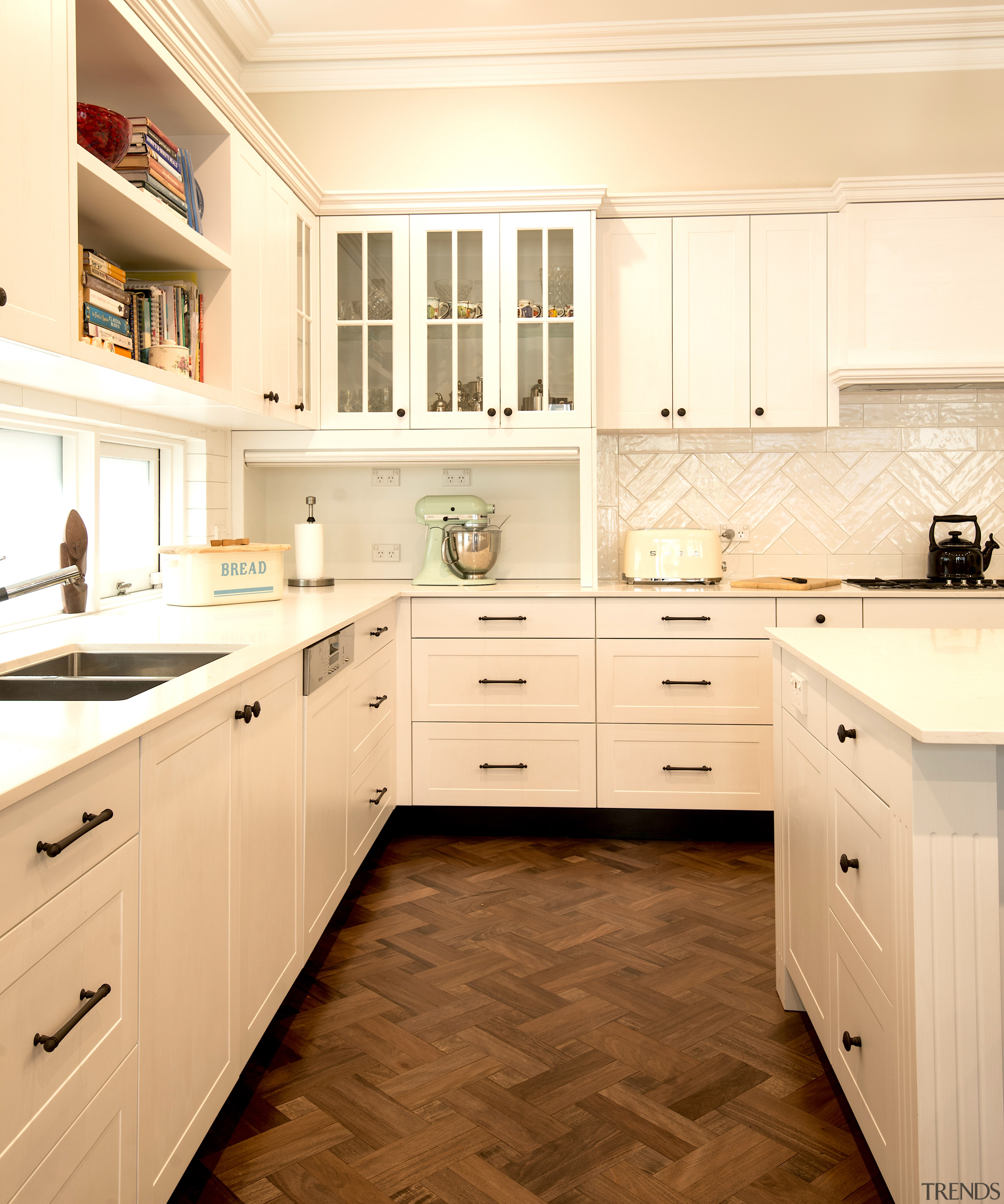 Glass-fronted cabinets break up this kitchen's wider use architecture, building, cabinetry, countertop, cupboard, drawer, floor, flooring, furniture, home, house, interior design, kitchen, material property, property, room, sink, tile, orange, yellow