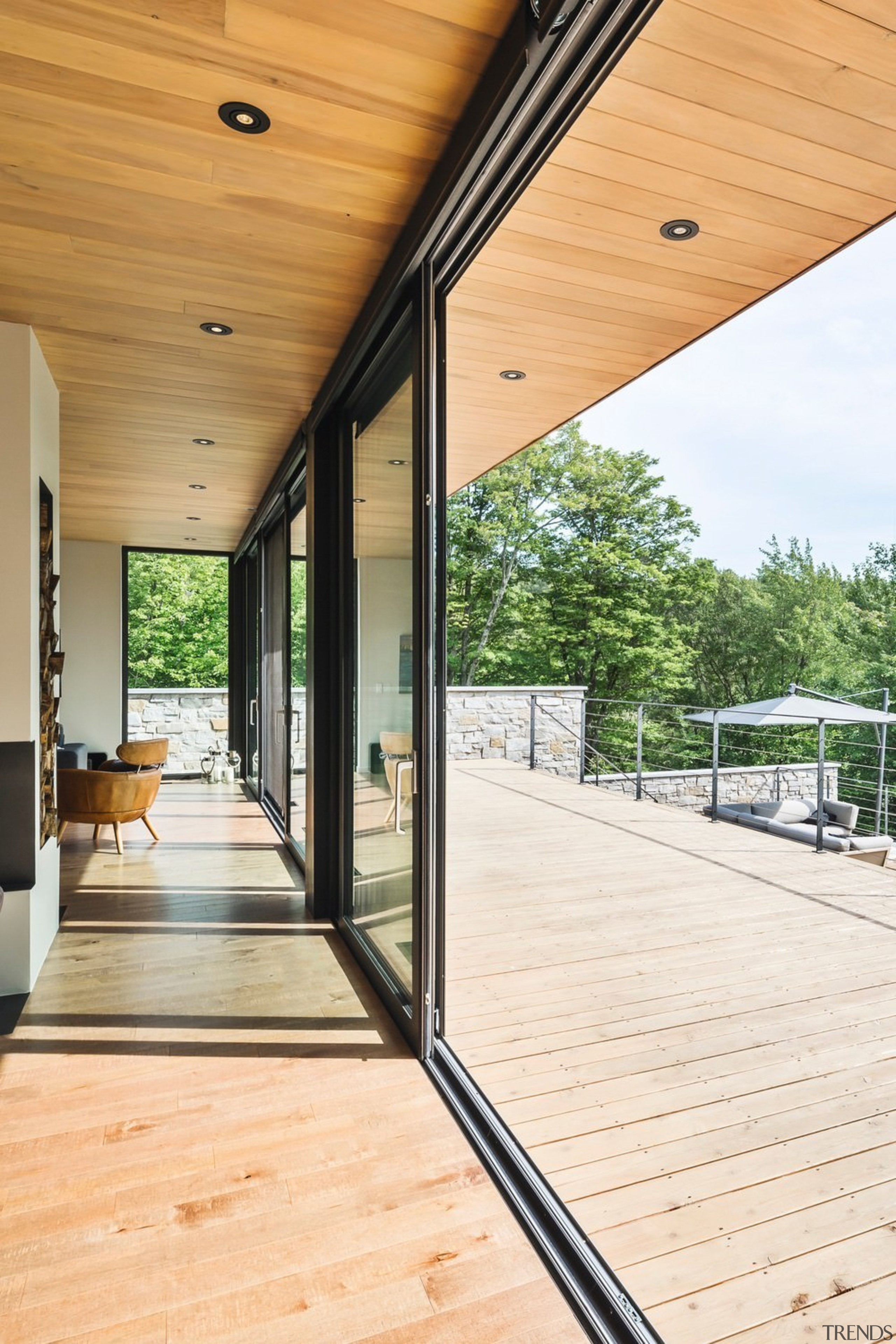 Giant sliders make the indoors and outdoors one architecture, daylighting, deck, door, floor, flooring, glass, hardwood, home, house, porch, real estate, window, wood, wood flooring, orange, white