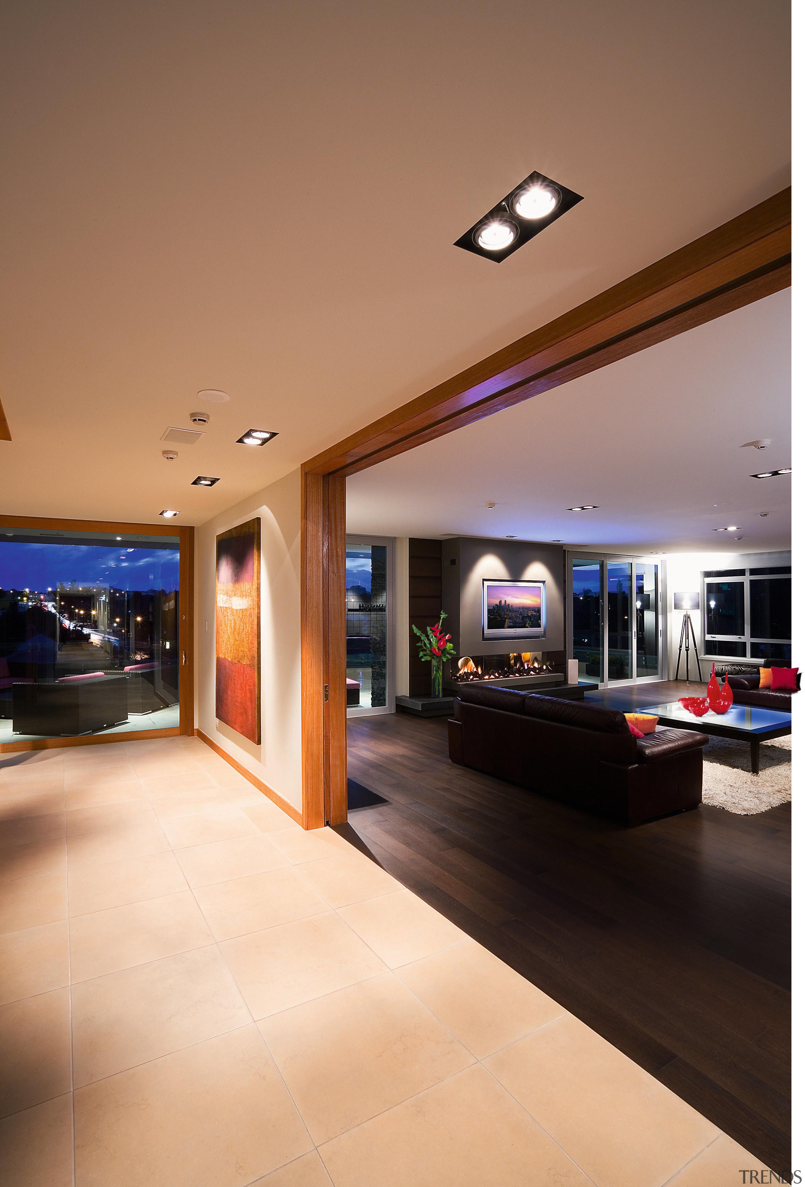 High end apartment.  Inner-city apartments. - High ceiling, floor, flooring, interior design, lighting, lobby, brown, orange