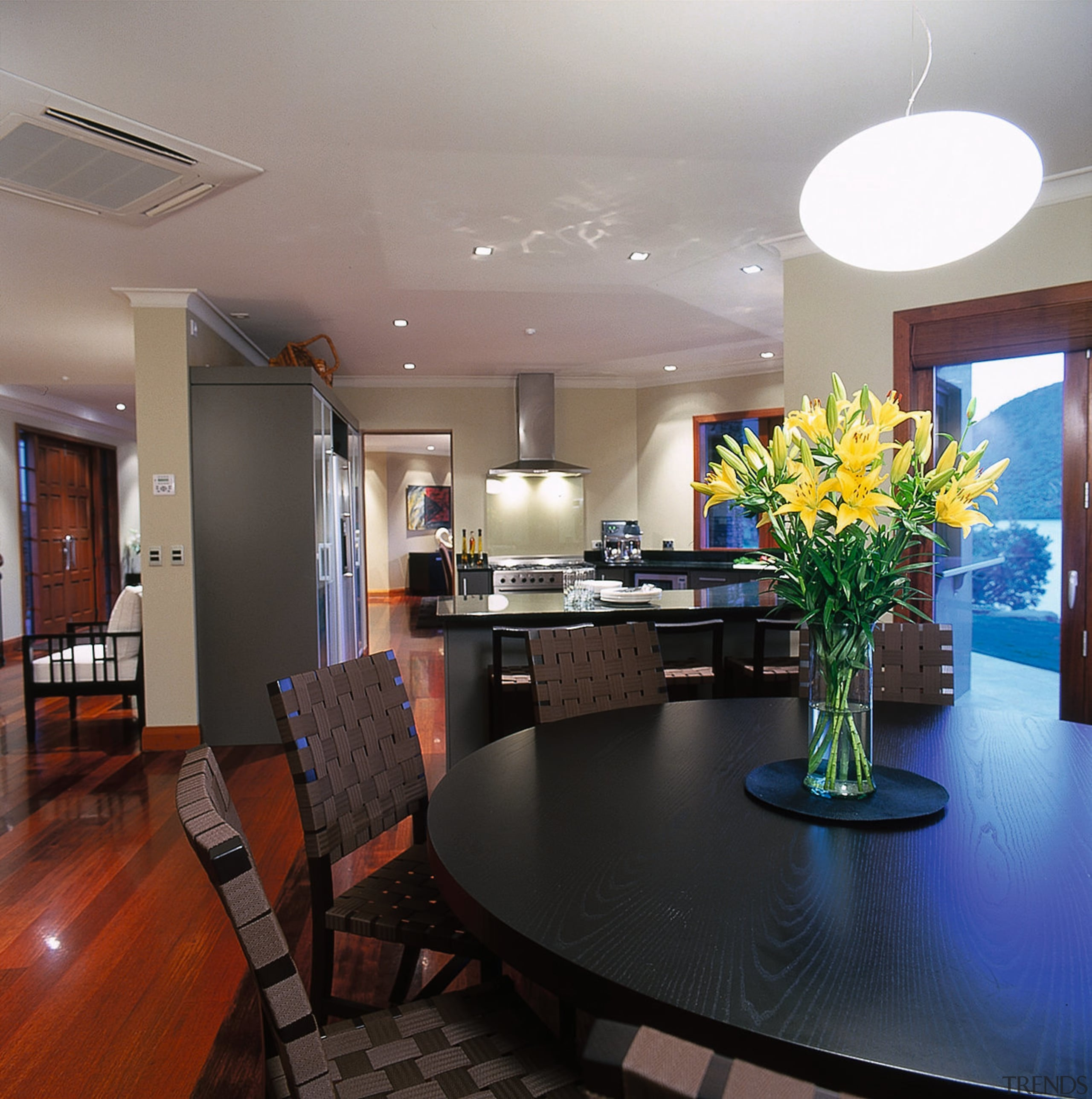 View of dining area. Features views of the apartment, ceiling, dining room, home, interior design, kitchen, living room, real estate, room, gray, black