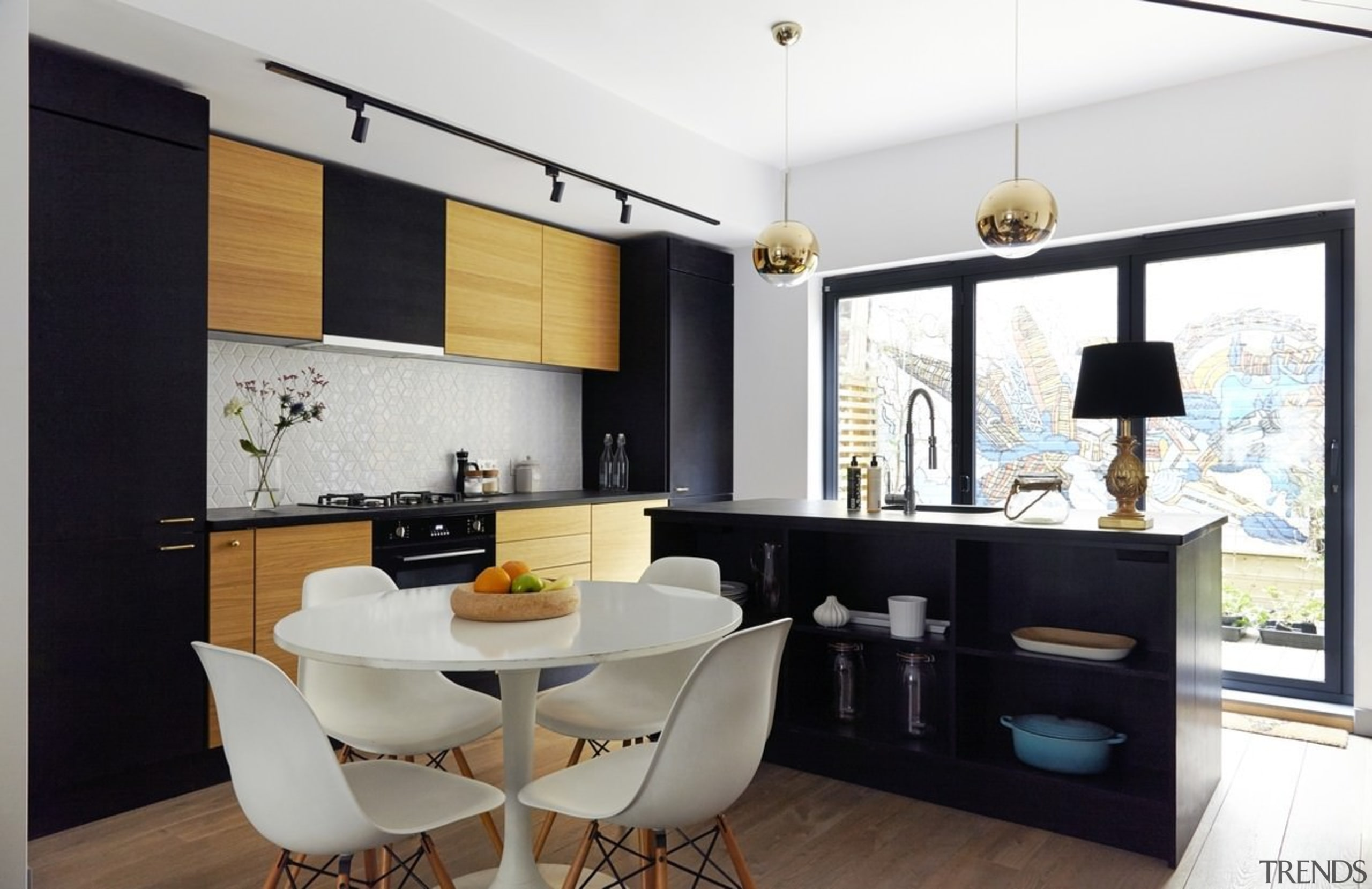 Arranging the island slightly differently means it's much ceiling, dining room, home, interior design, interior designer, living room, property, real estate, room, white, black