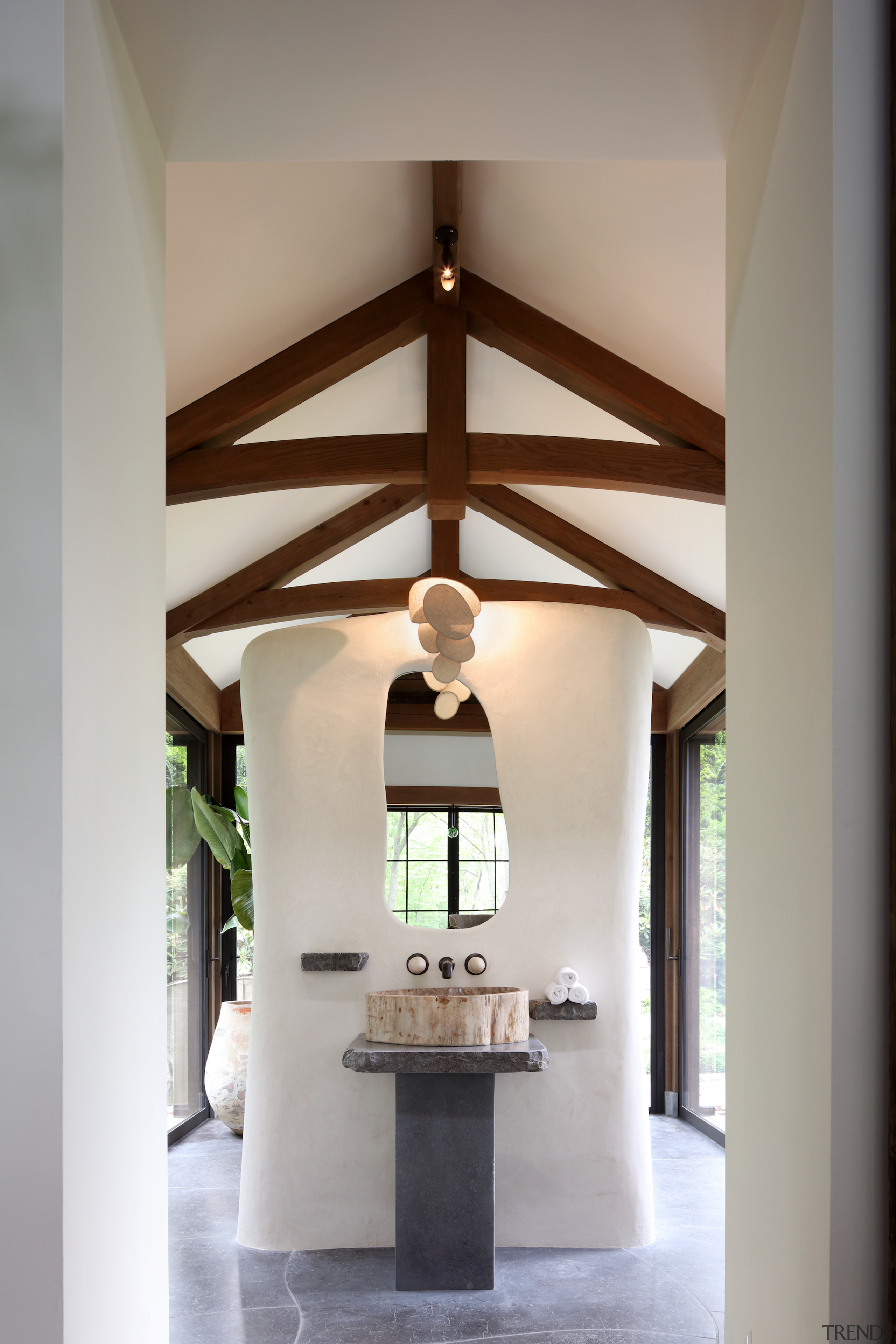 This dramatic bathroom reflects the home's merger of